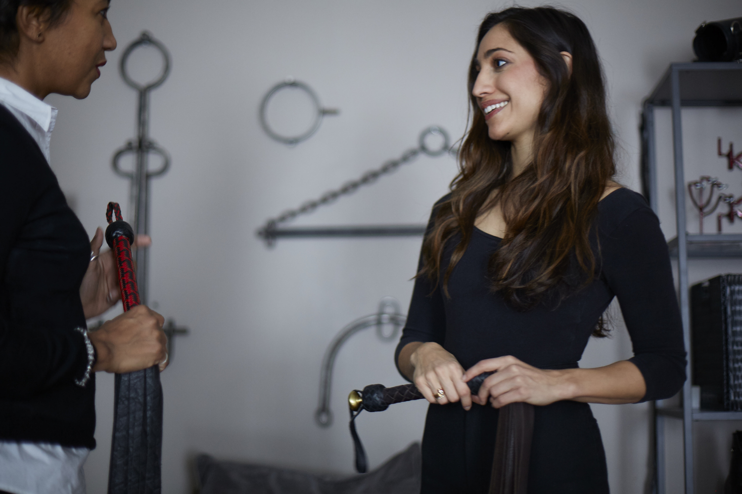 Olivia Troy, left, explains whip technique to an actor at the Kink On Set studio.