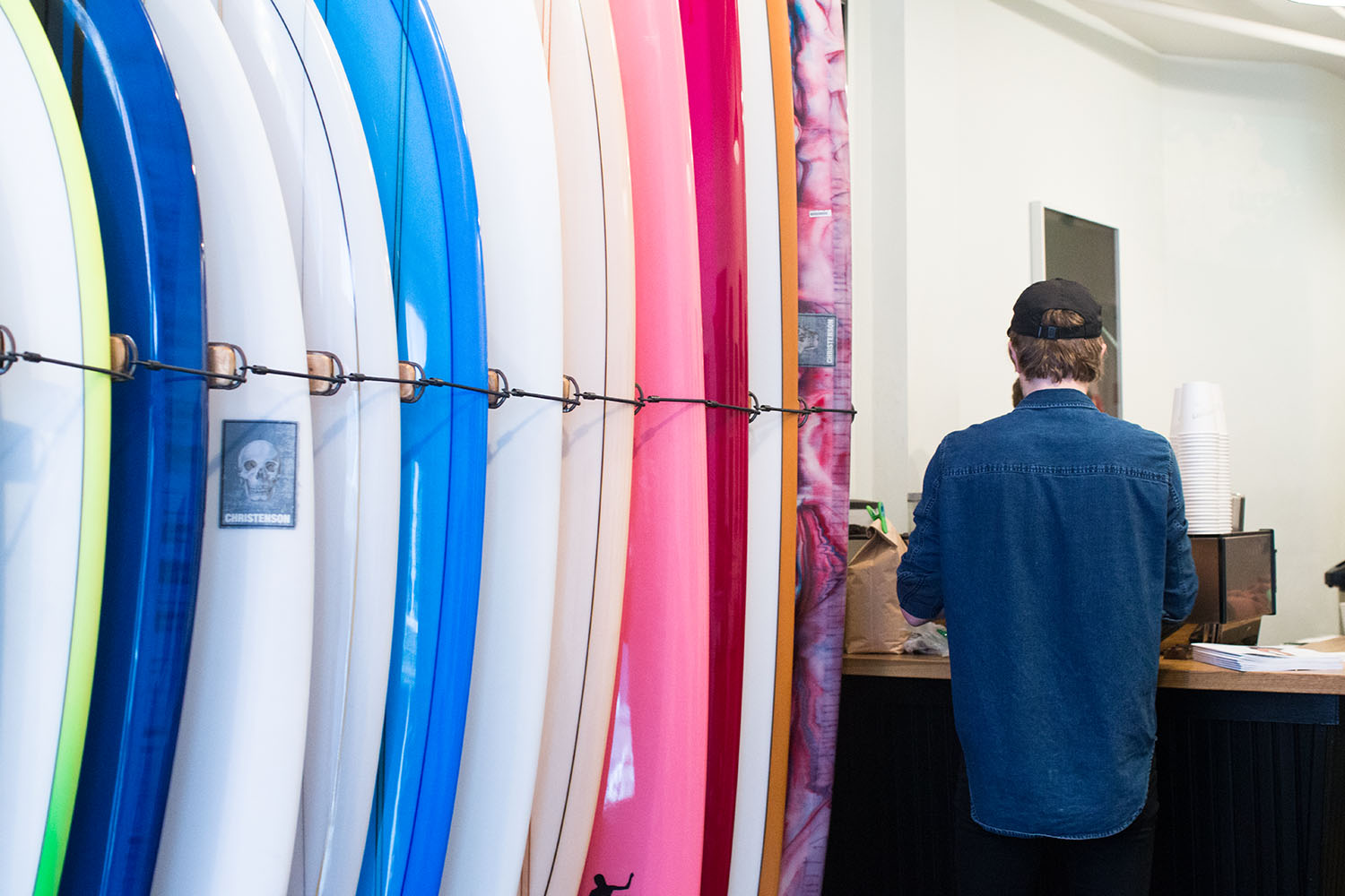A coffee counter tucked in behind the surfboards at  Saturdays NYC  in Soho.