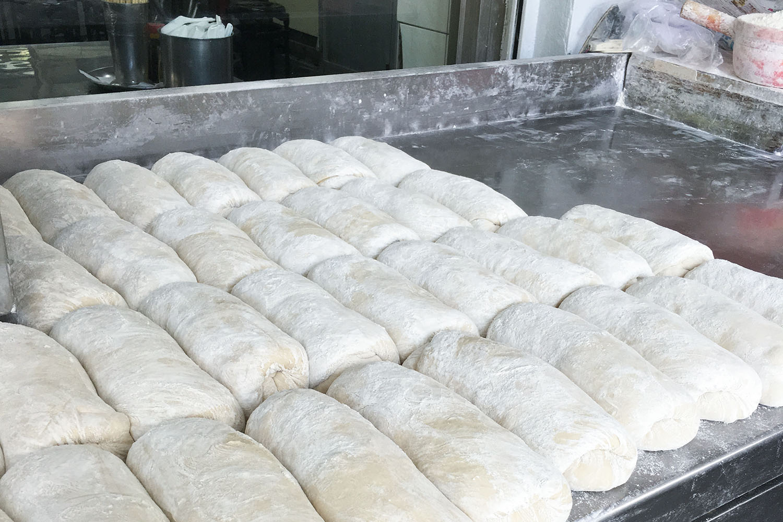 You tiao dough rising at 24 HR Yong He Dou Jiang breakfast store in Da'An District