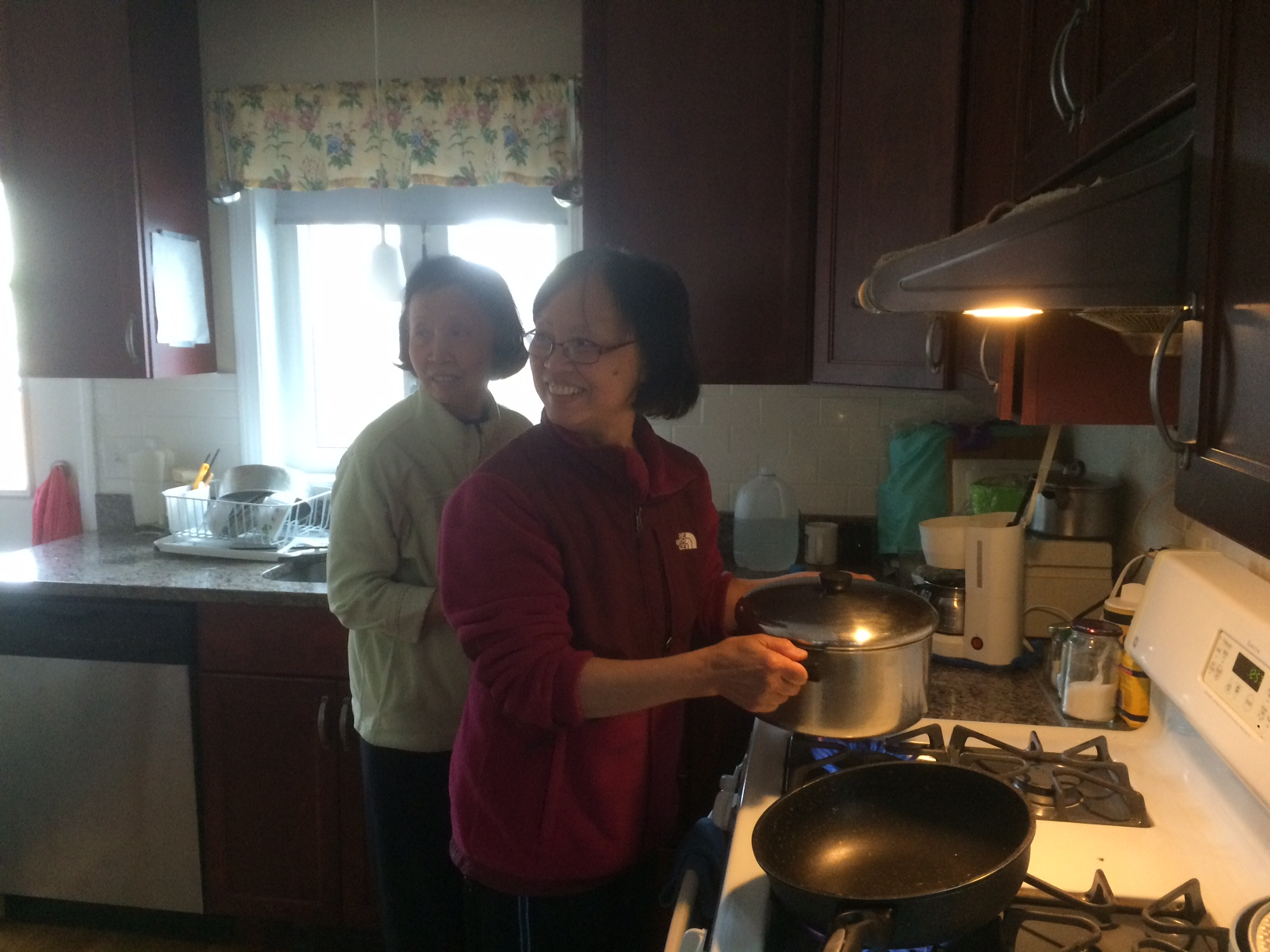 Di Phung and Di Minh making lunch