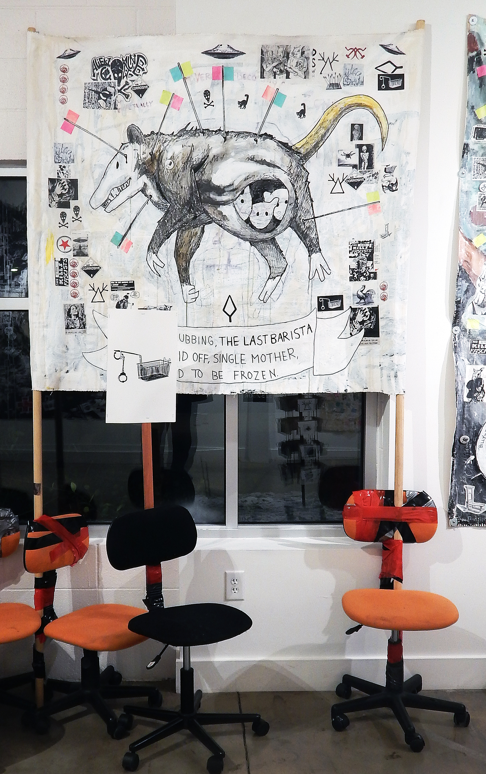 The Last Barista.  Acrylic, stickers, marker, photocopies, buttons, post-it notes, coffee and mixed media on canvas banner with poles (installation view). (2018) (Adam Turl)