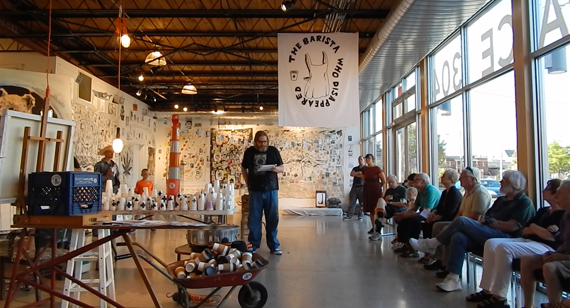Artist talk at the opening of The Barista Who Disappeared at Artspace 304 (Carbondale, Illinois) (Summer 2018).