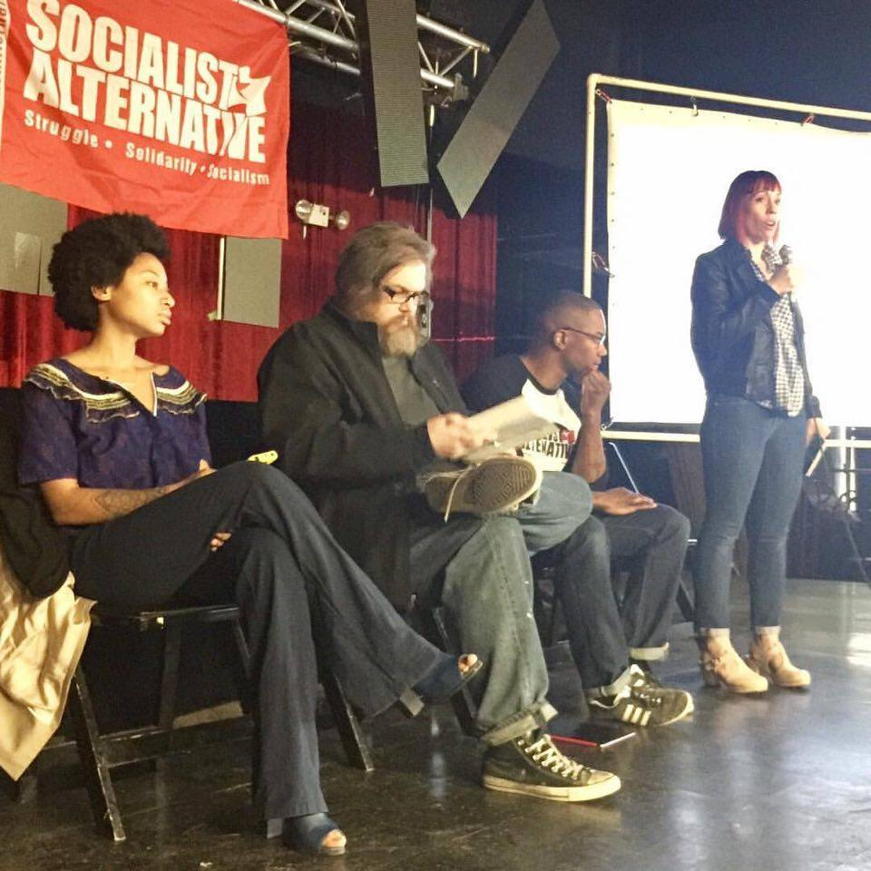 "Mass ""resistance"" meeting organized by Socialist Alternative St. Louis. Sunni Hutton, Adam Turl, Ashton Rome, Sarah de Lacie. Photograph by Richard Reilly (2017)"