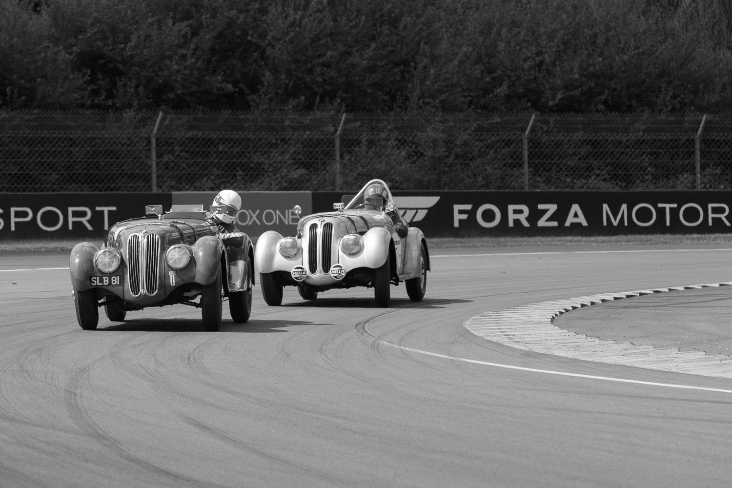 A pair of BMW 328s