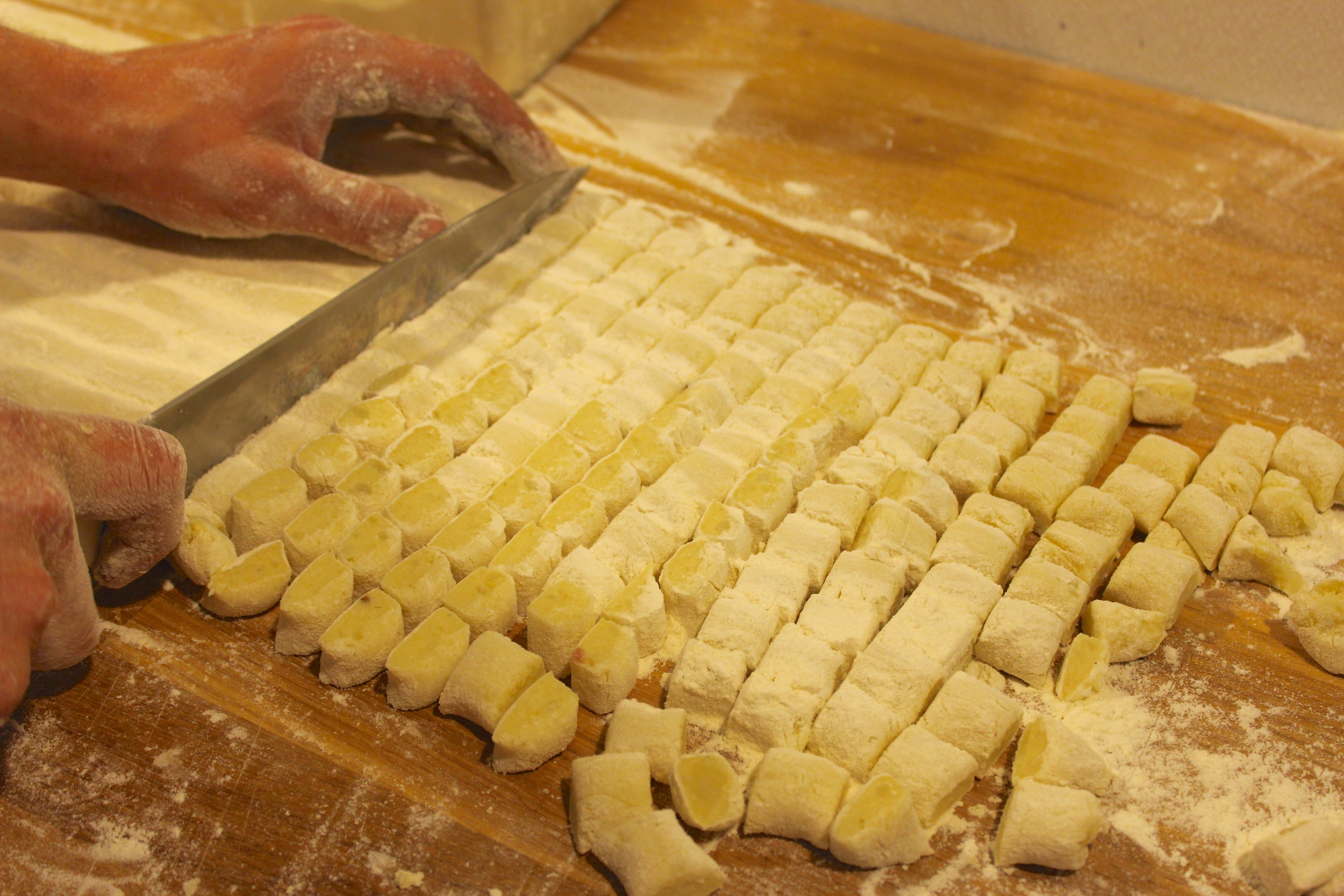 cutting gnocchi with a knife