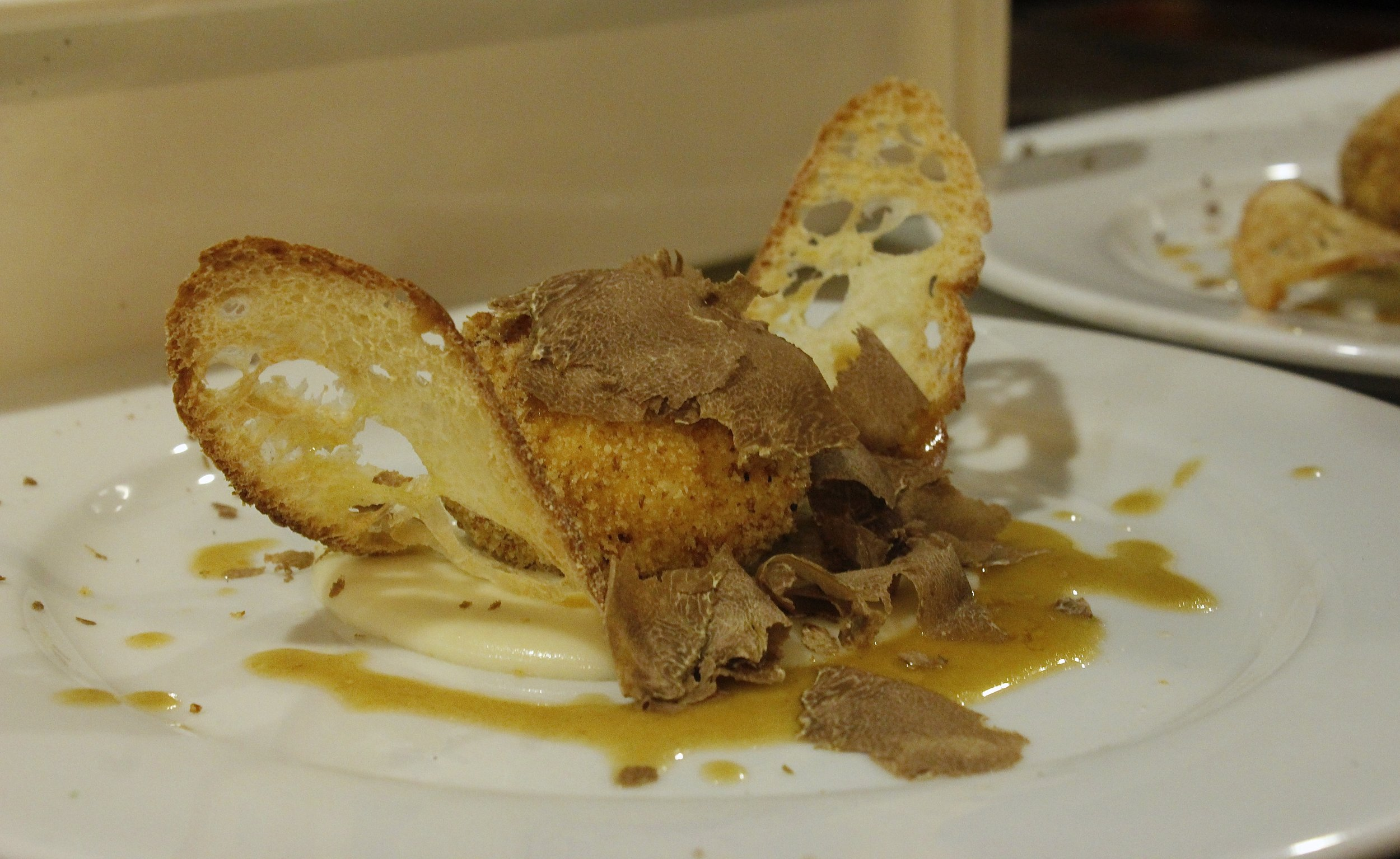 picture of cooked egg dish with truffle
