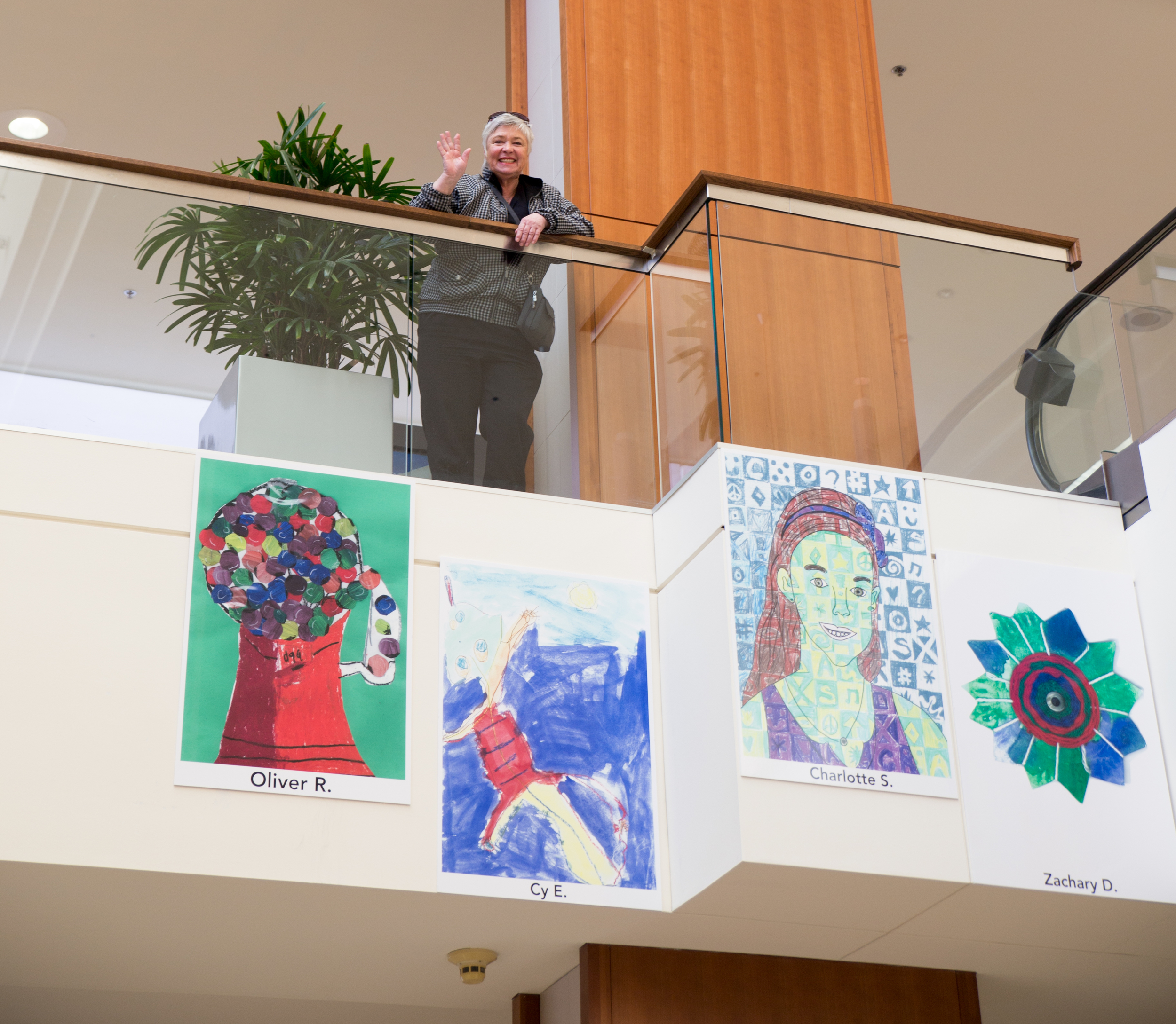 Nan Emmer waves above her grandson Cy's artwork (lizard.)