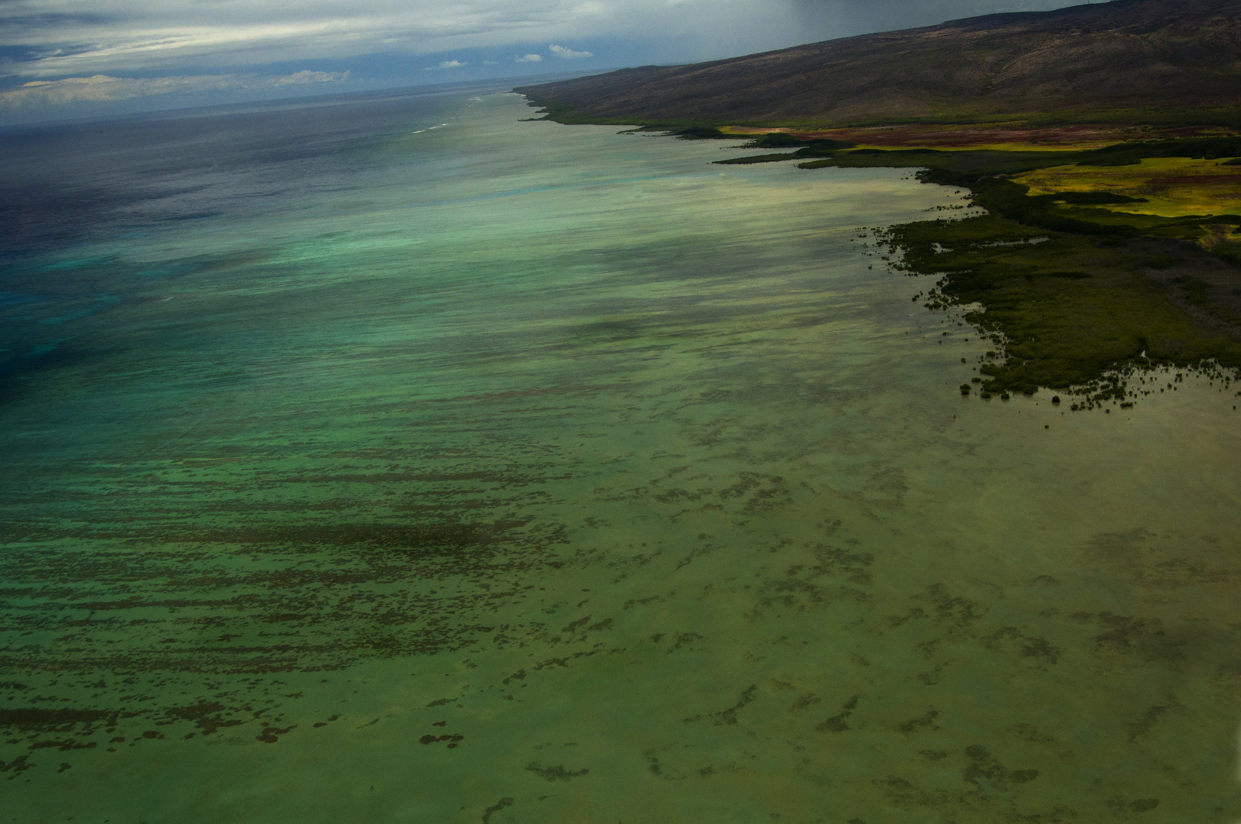 Ariel view of fringing reef and the flats created by the reef, where bonefish are targeted.