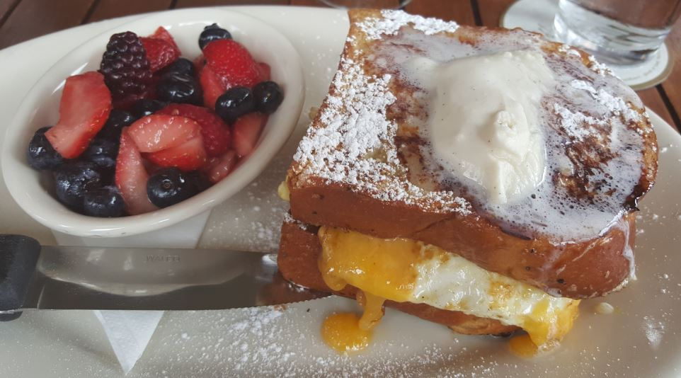 French Toast Sandwich with a Side of Fruit