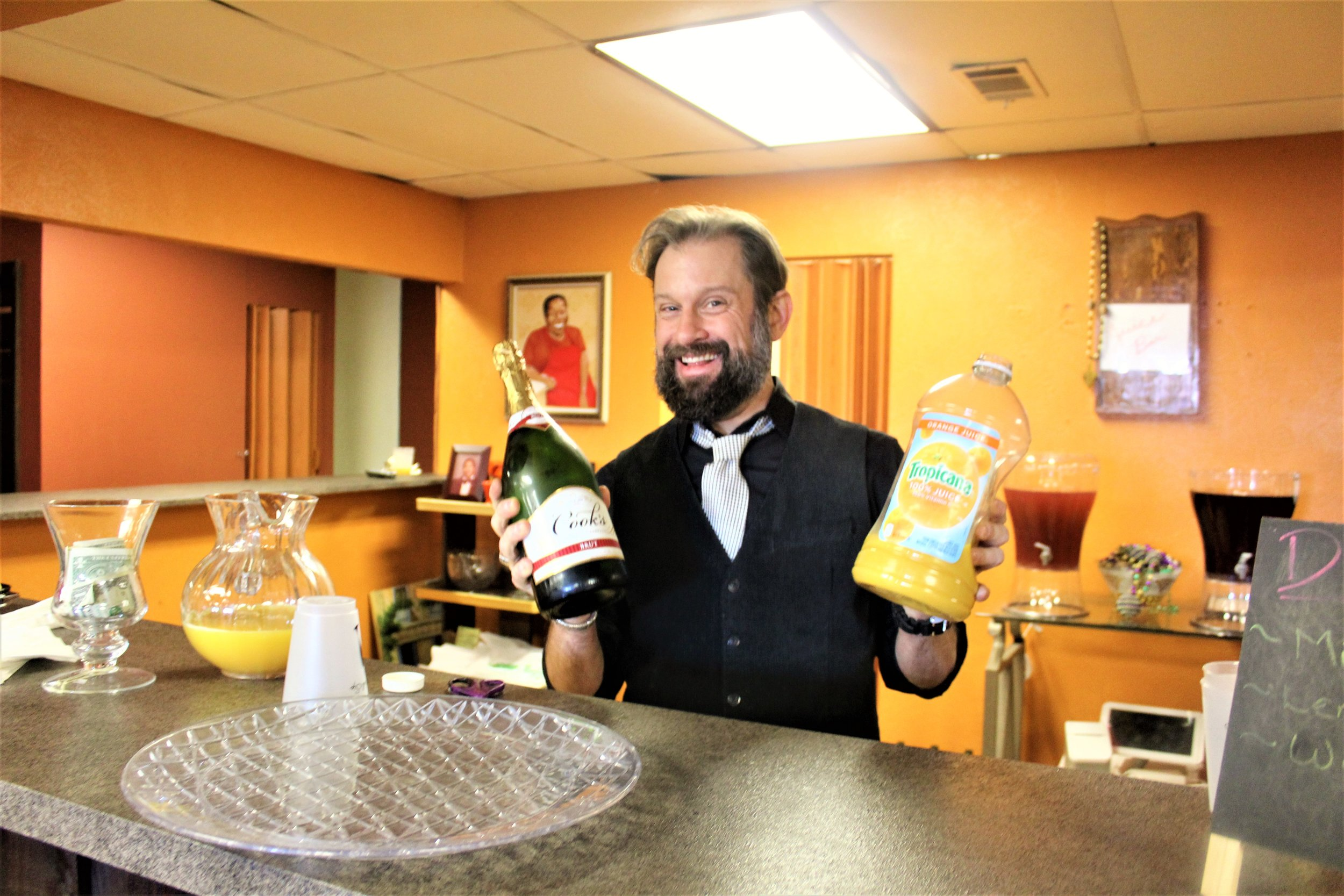 Our bartender serving up endless mimosas with a smile you just can't help but to love.
