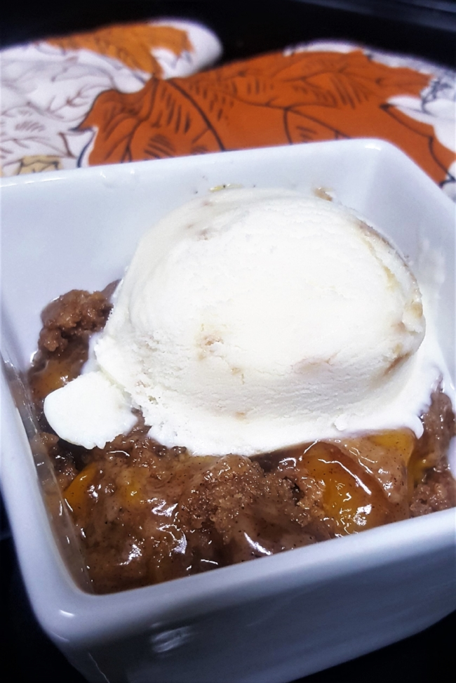 Final Peach Dump Cake with a scoop of ice cream