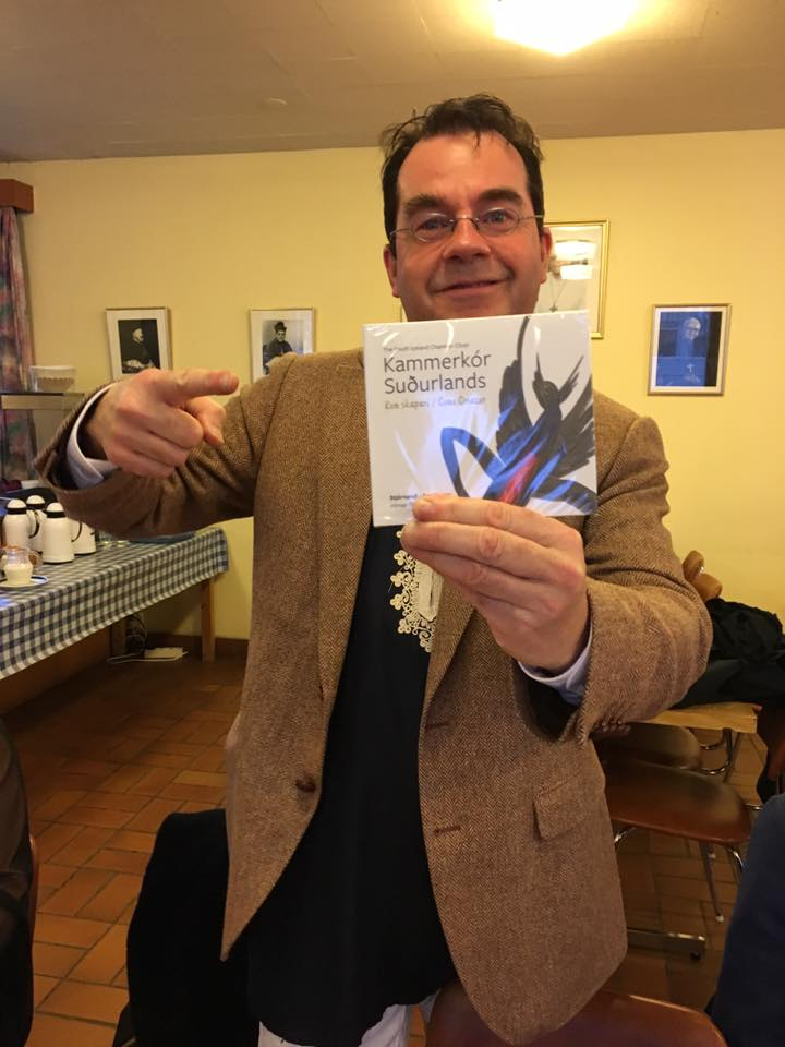 Hilmar Örn Agnarsson, SICC's conductor and founder, proudly presents the first copy of the album.