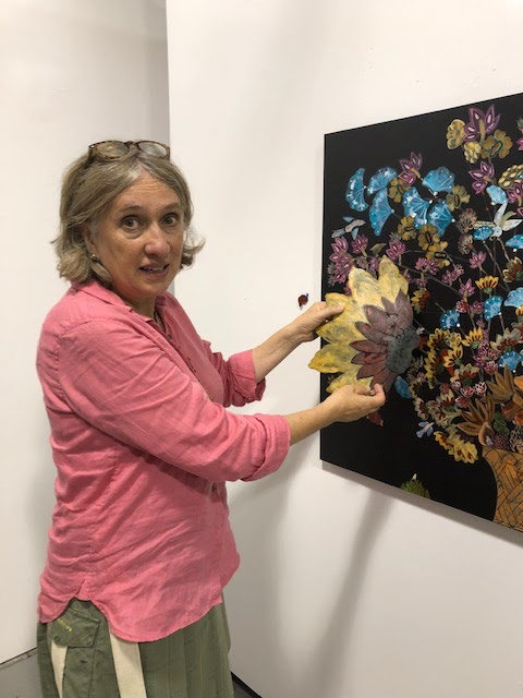 "Nancy Friedemann-Sánchez, at her studio, ""Fiendish Plots,"" in Lincoln, Nebraska, working on one of her ""Cornucopia"" pieces"