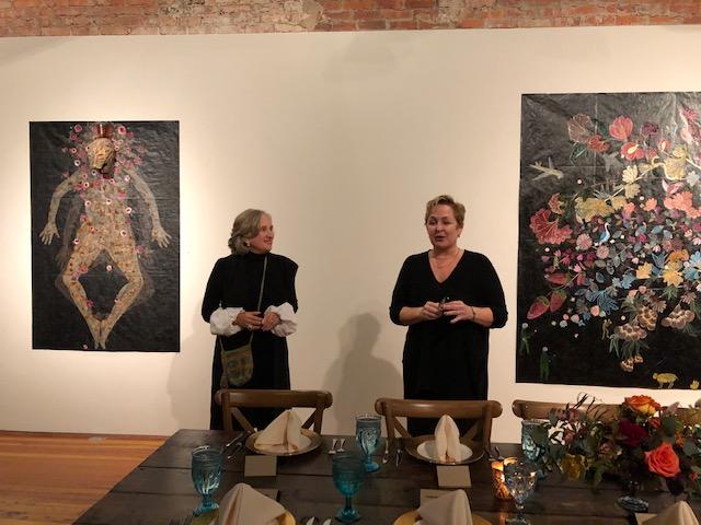 Nancy Friedemann-Sánchez and Kim Weinberger discussing her work.