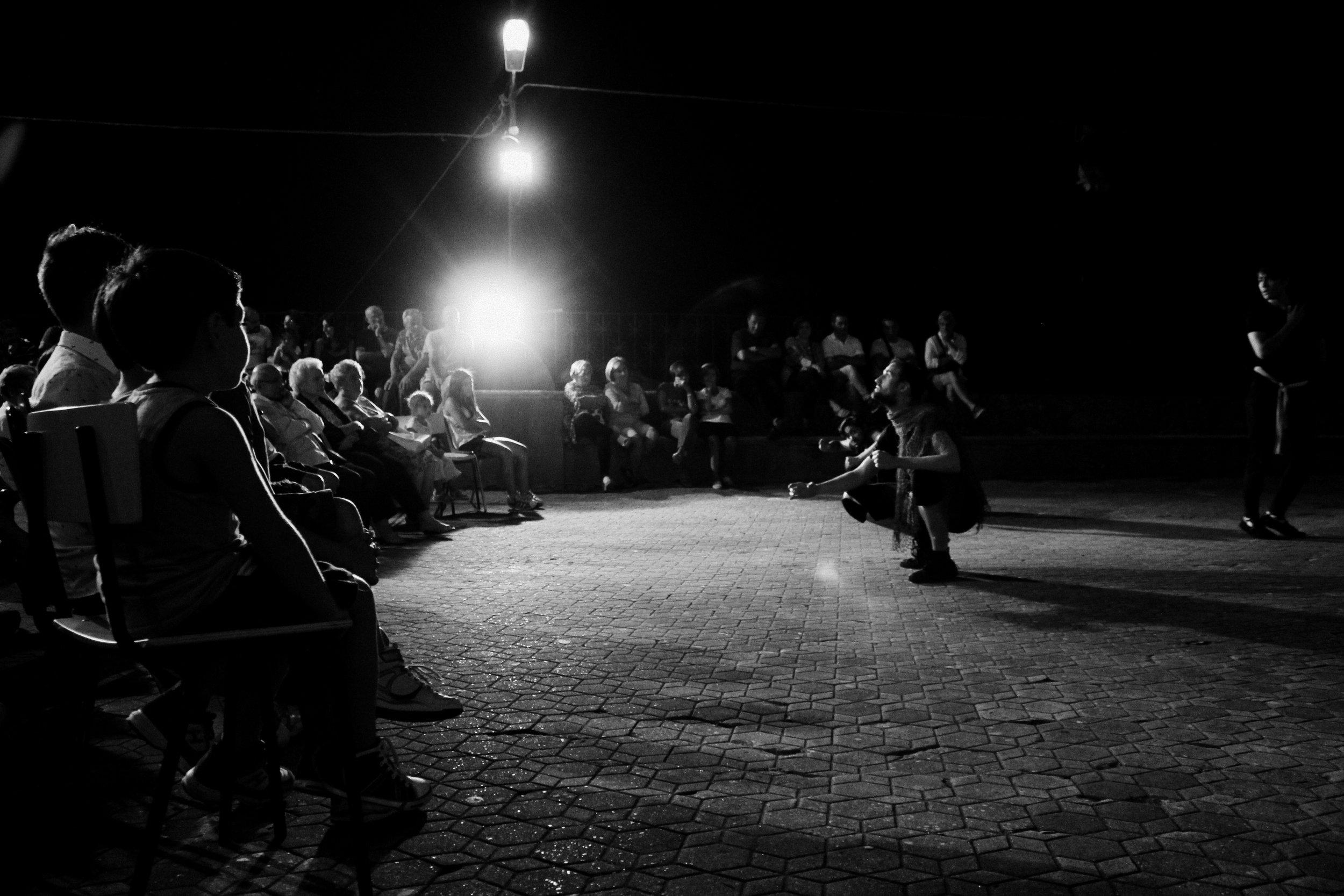 Copy of Company members perform in the piazza San Nicolò di Bari in Pezzolo