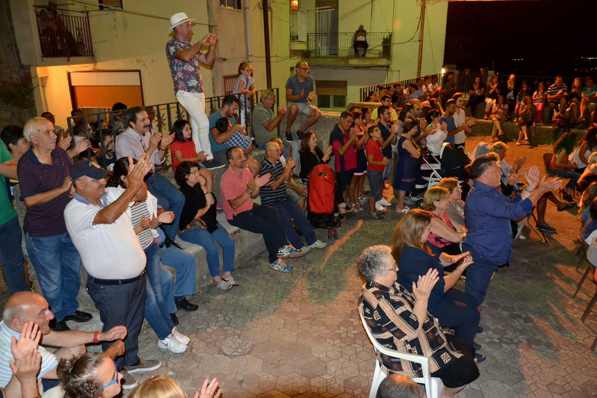 The crowd applauds the opening night performance of La Storia di Colapesce
