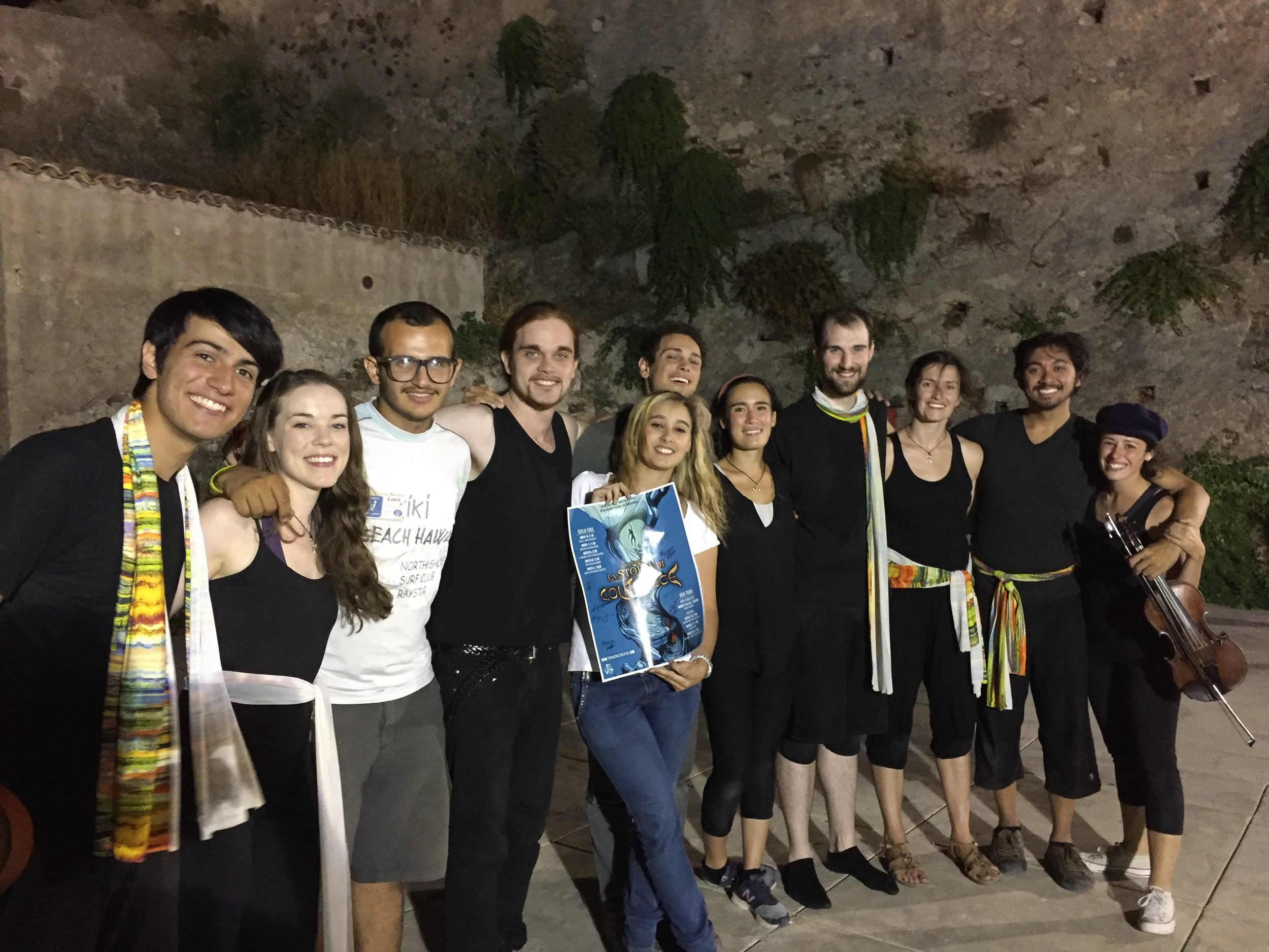 Company members pose with Castello Rufo Ruffo staff at the end of the performance