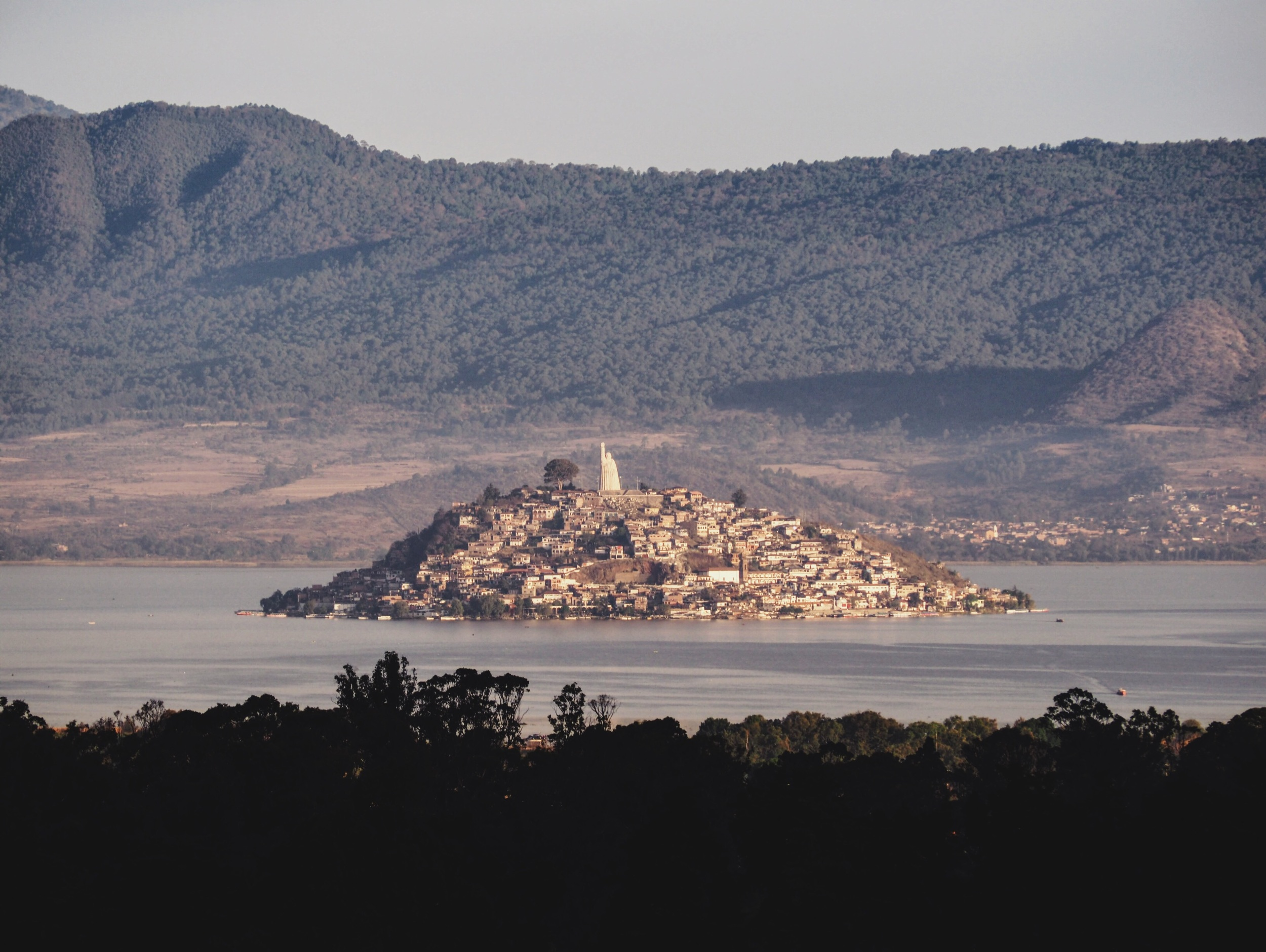 View of Isla de Janitzio from our adobe casita Pátzcuaro, with the giant statue of José María Morelos at the top