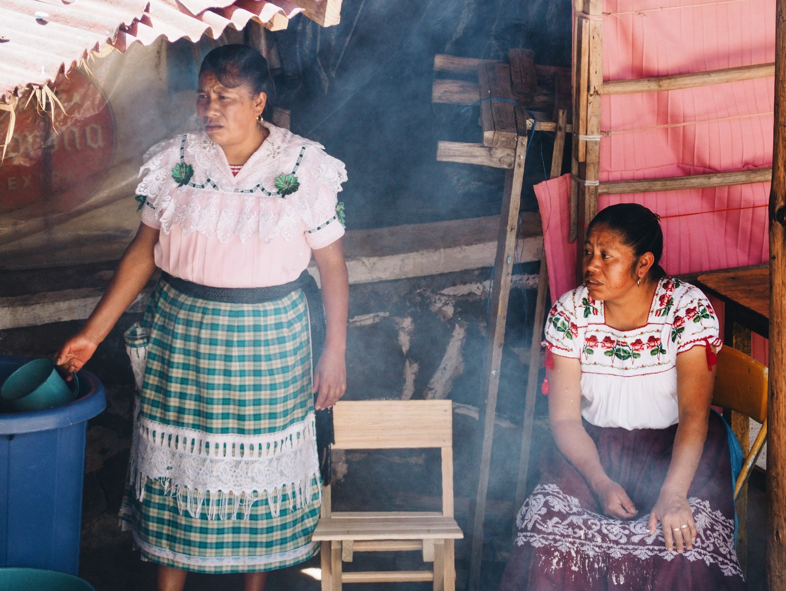 Local women making atole – a traditional hot, sweet drink made from corn, milk, sugar & cinnamon