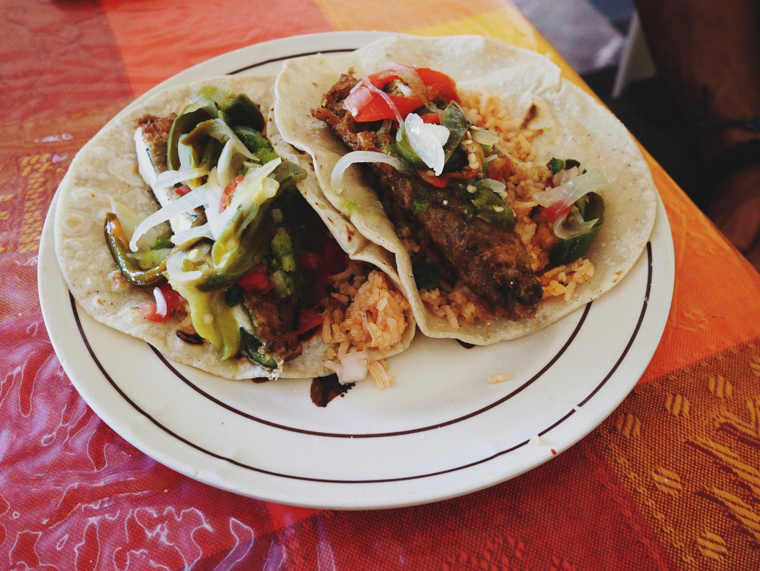 Chile rellenos tacos with all the fixings: guacamole, rice, rajas, salsa and queso fresco