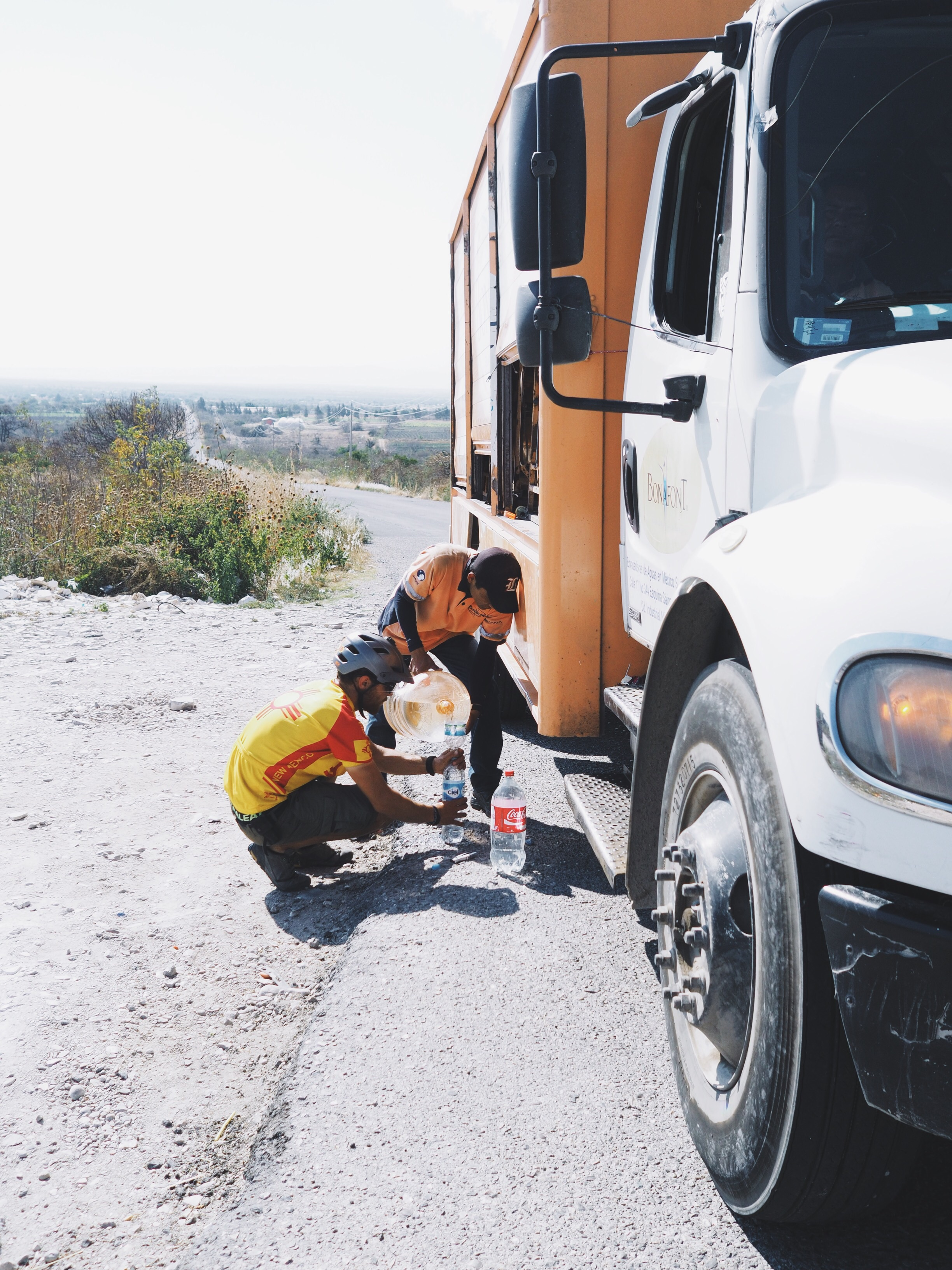 Filling up our bottles from a water truck!