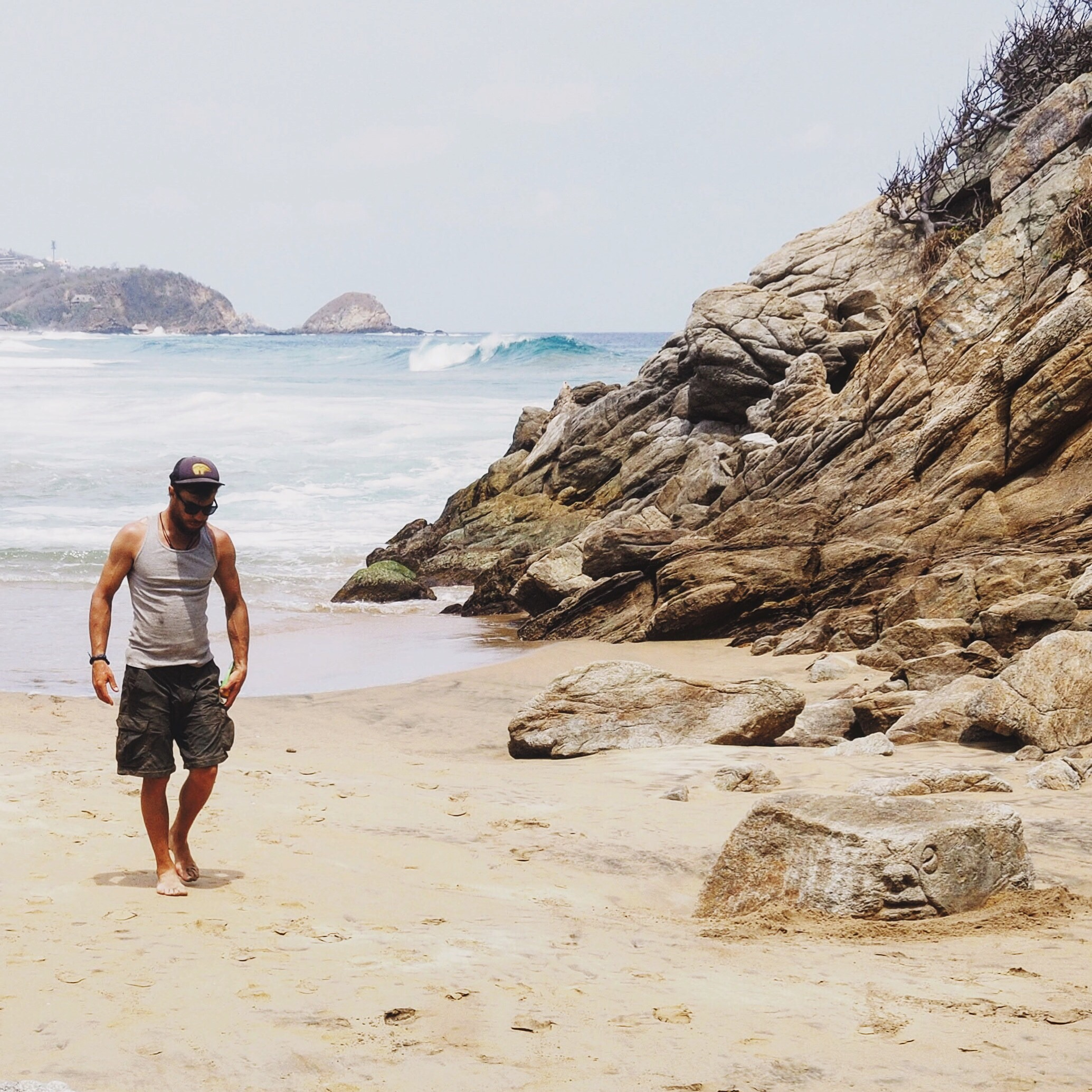 Zipolite - check out the carved face on the rock on the beach!