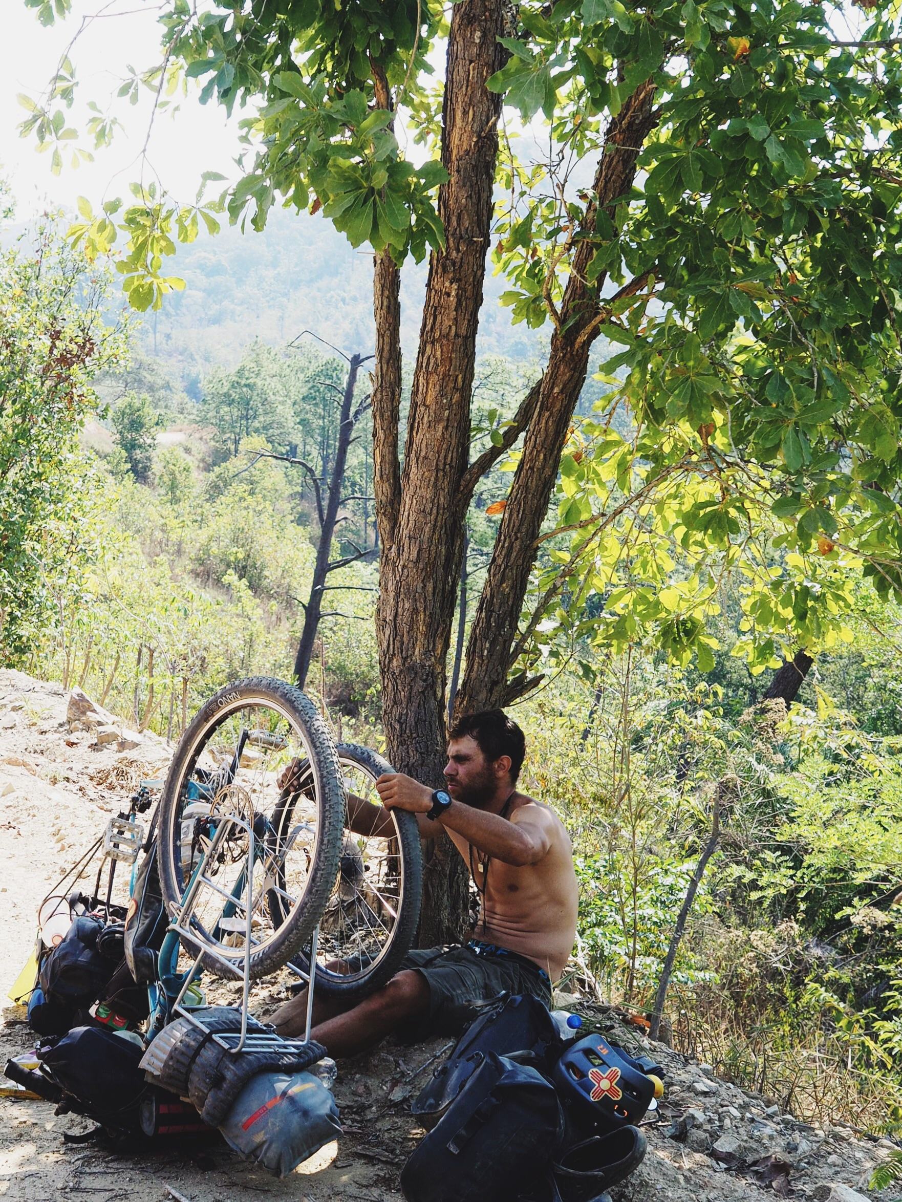 Mehedi fixing a flat on our descent