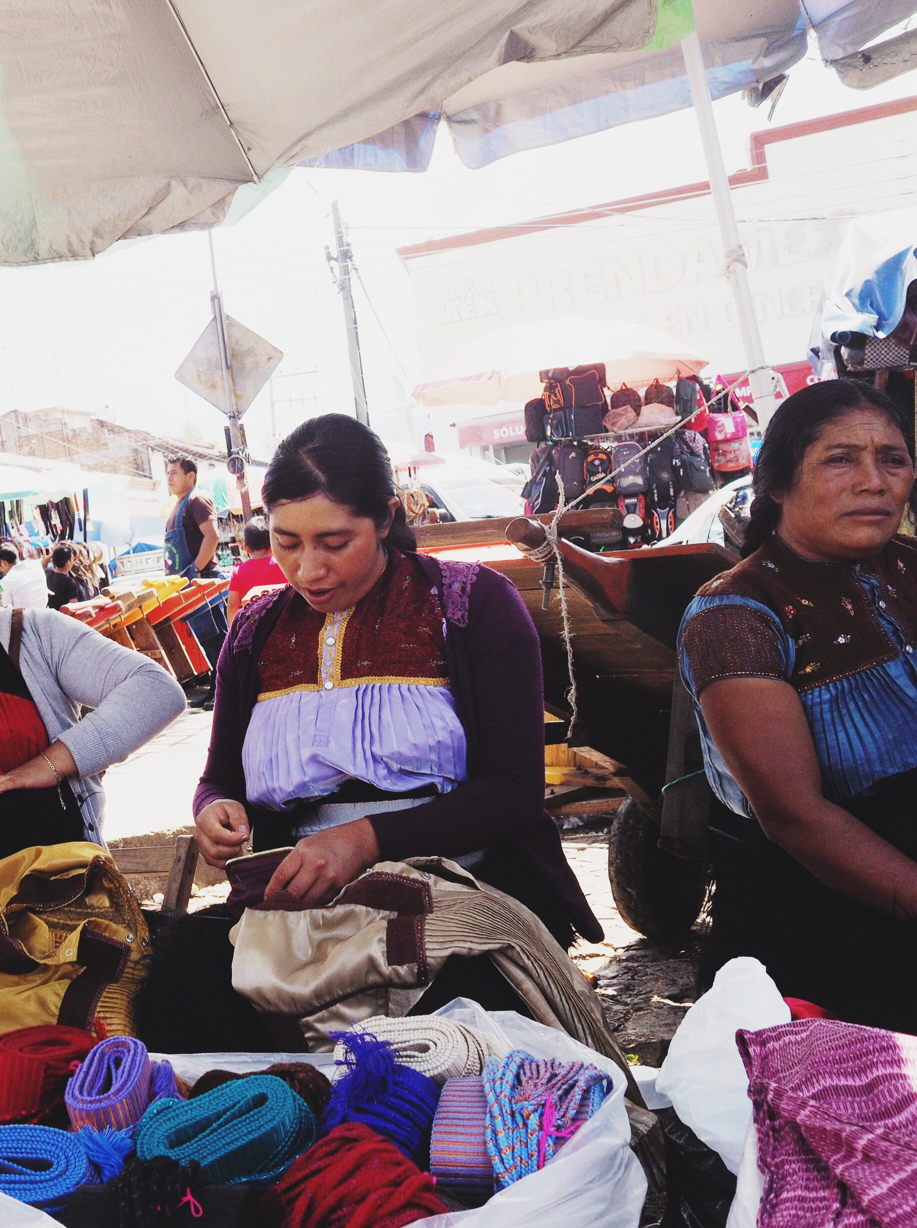 Women selling hand-made belts at the market