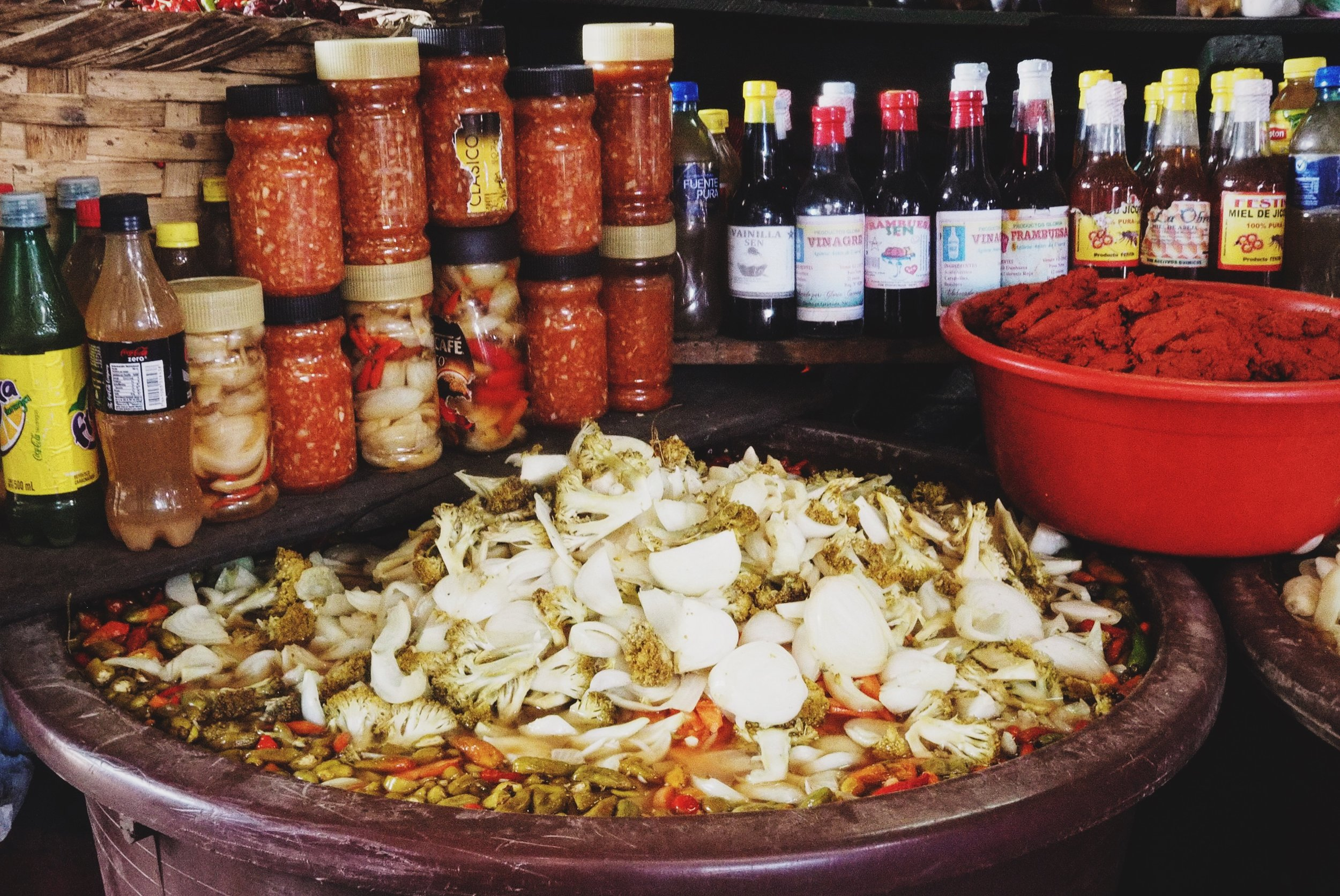 """Local salsa picante is called """"repollo"""" – a vinegar based brine for picking peppers, cabbage, onions, garlic and a load of spices. Absolutely delicious, and we added it to just about every plate of food we bought throughout Nicaragua"""