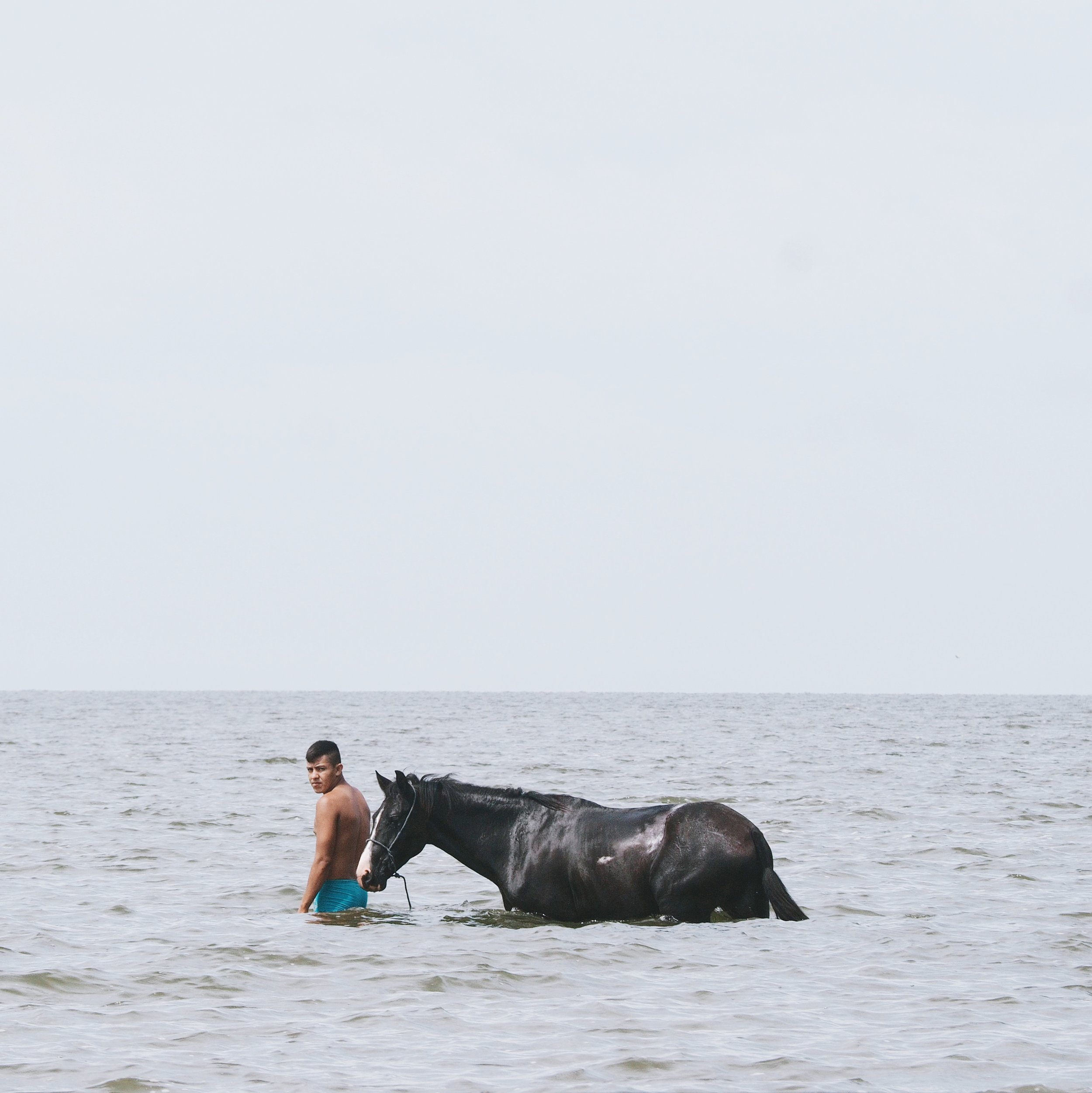 In the late afternoon we stopped lakeside for a dip and saw this local guy bathing his horse in the lake.