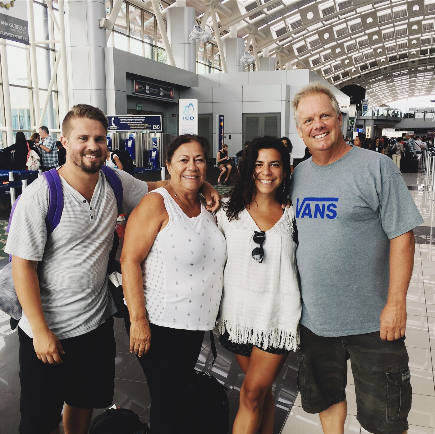 Erin's brother Kevin, mother Laura, and stepdad Scott in the San Jose airport