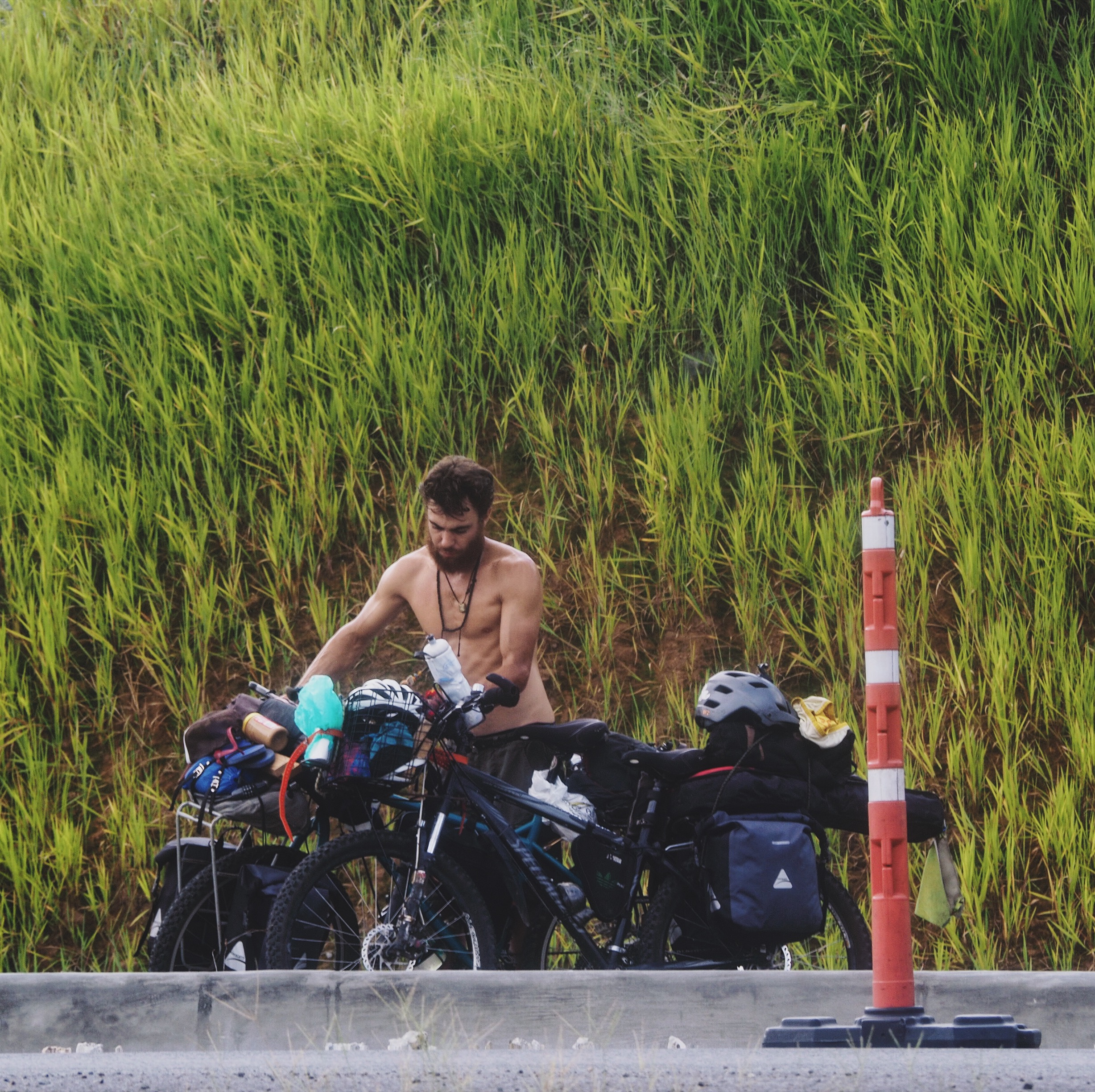 Mehedi balances the bikes on each other as we take a roadside break