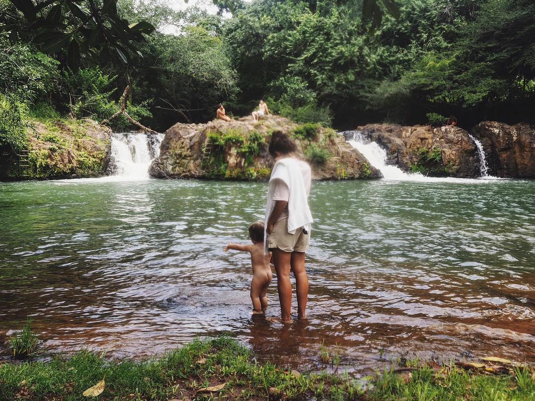 Stephanie and little Maya in the swimming hole