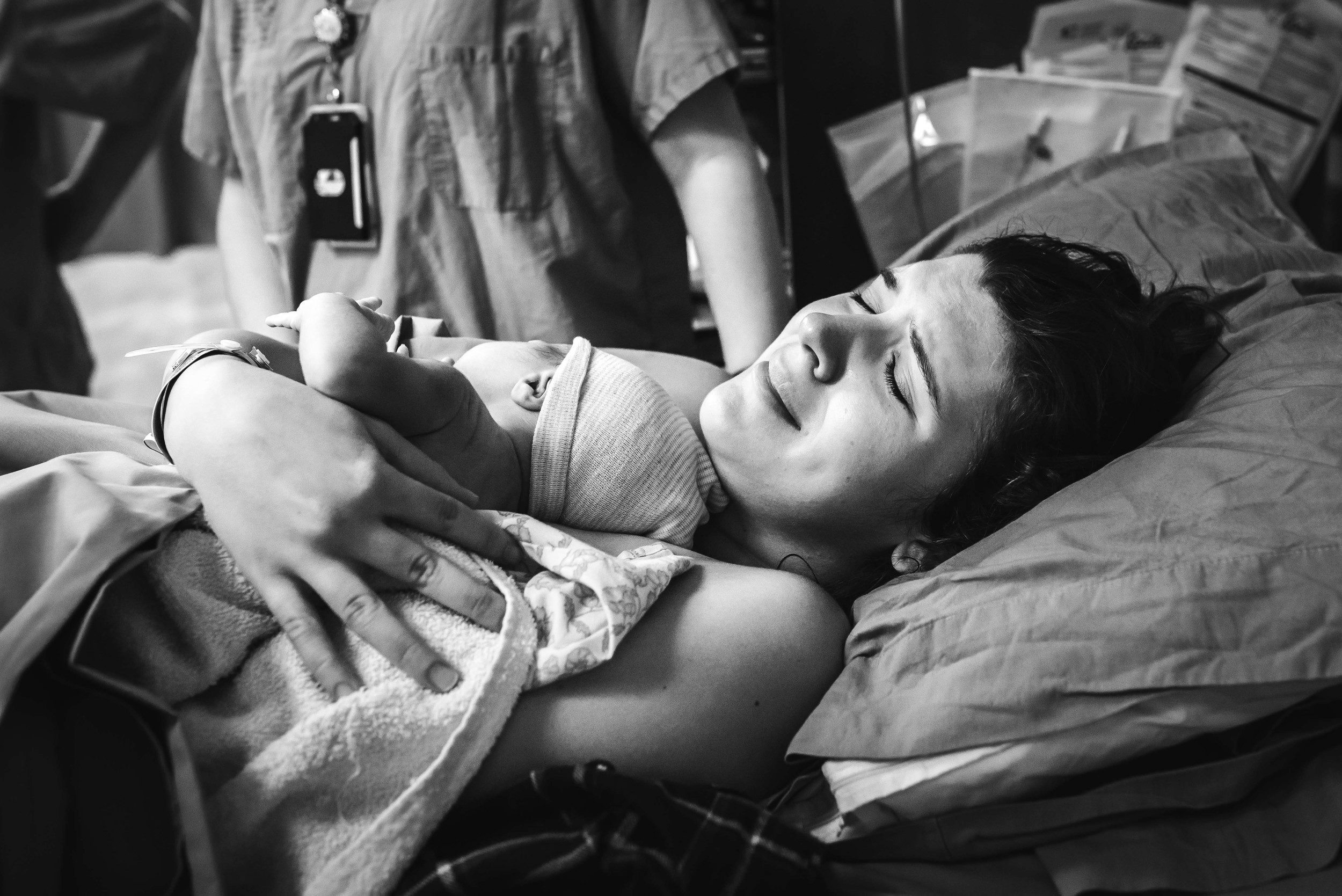 mother holds newborn baby in hospital