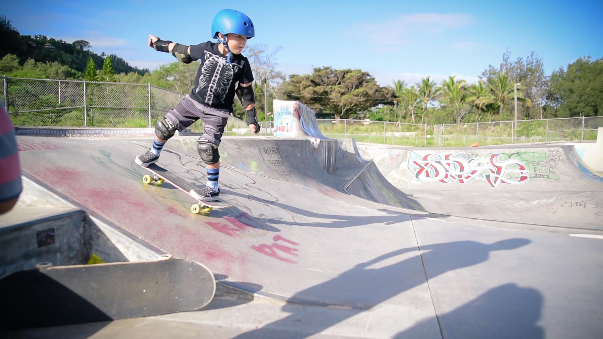 boy riding skate board by springfield illinois photographer lydia stuemke