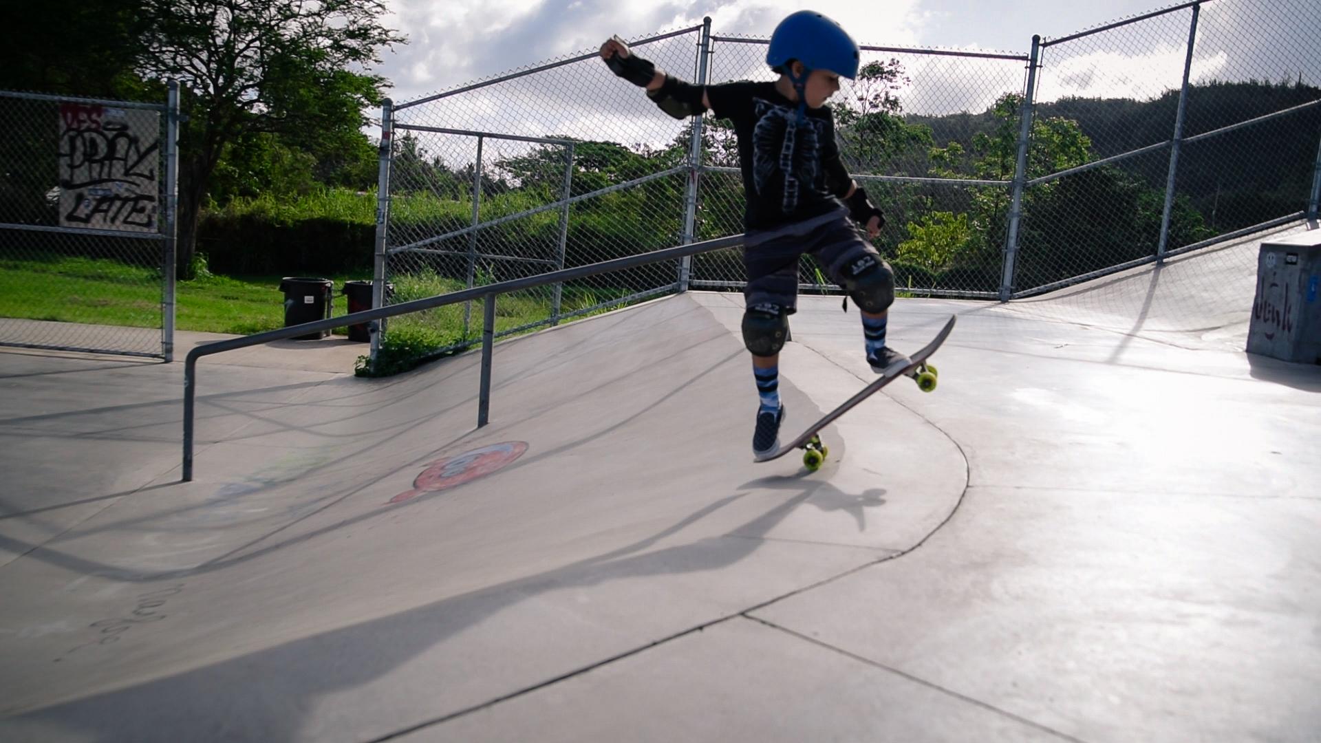 boy having fun on skateboard by springfield illinois photographer lydia stuemke