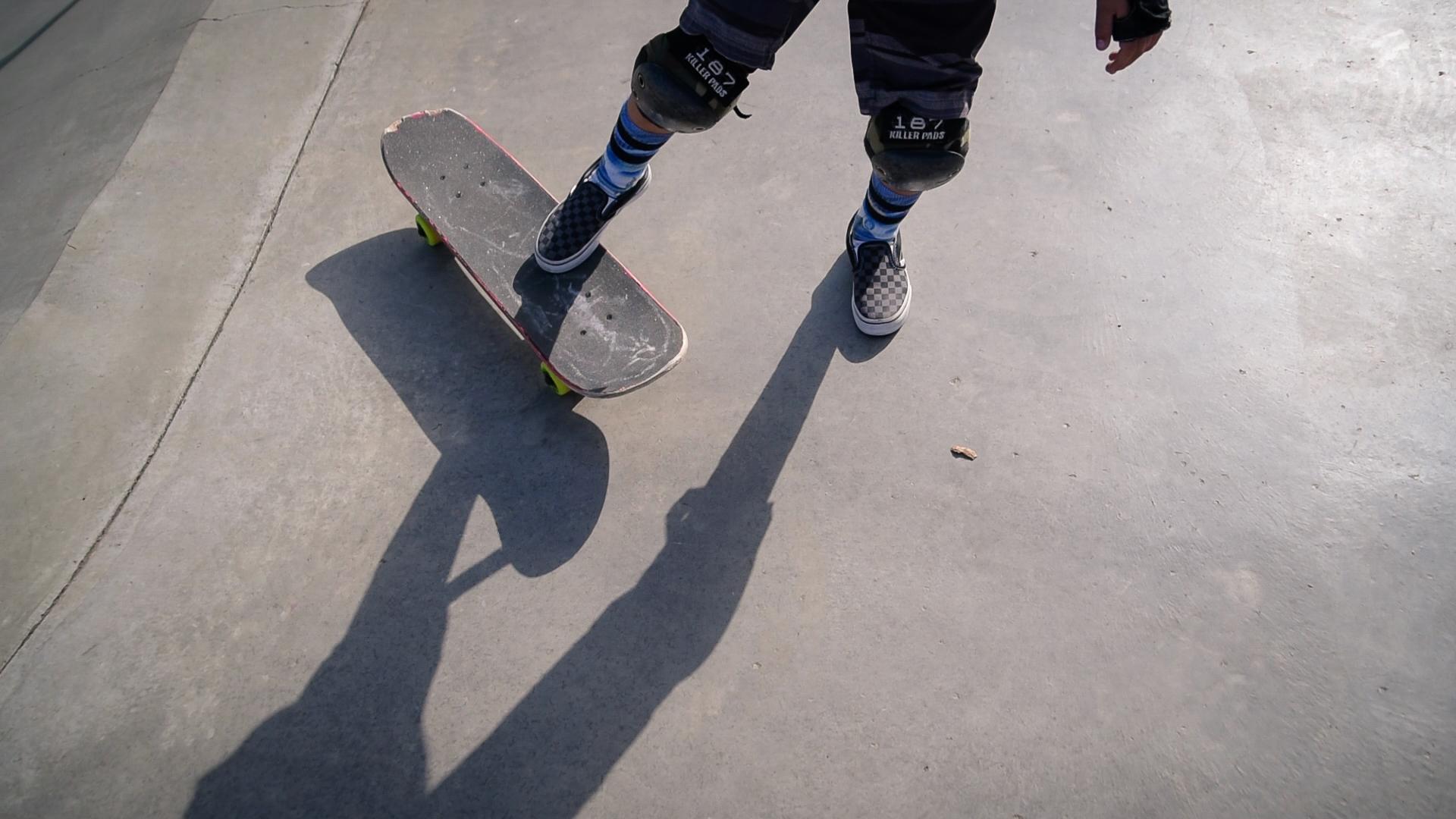 young boy's feet on skateboard by springfield illinois photographer lydia stuemke