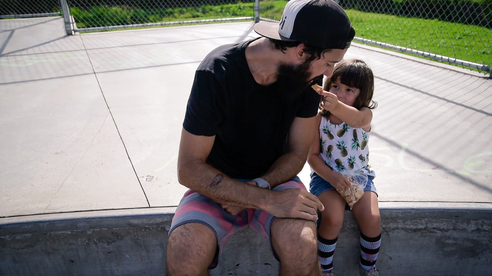 daughter feeding dad a snack by springfield illinois photographer lydia stuemke