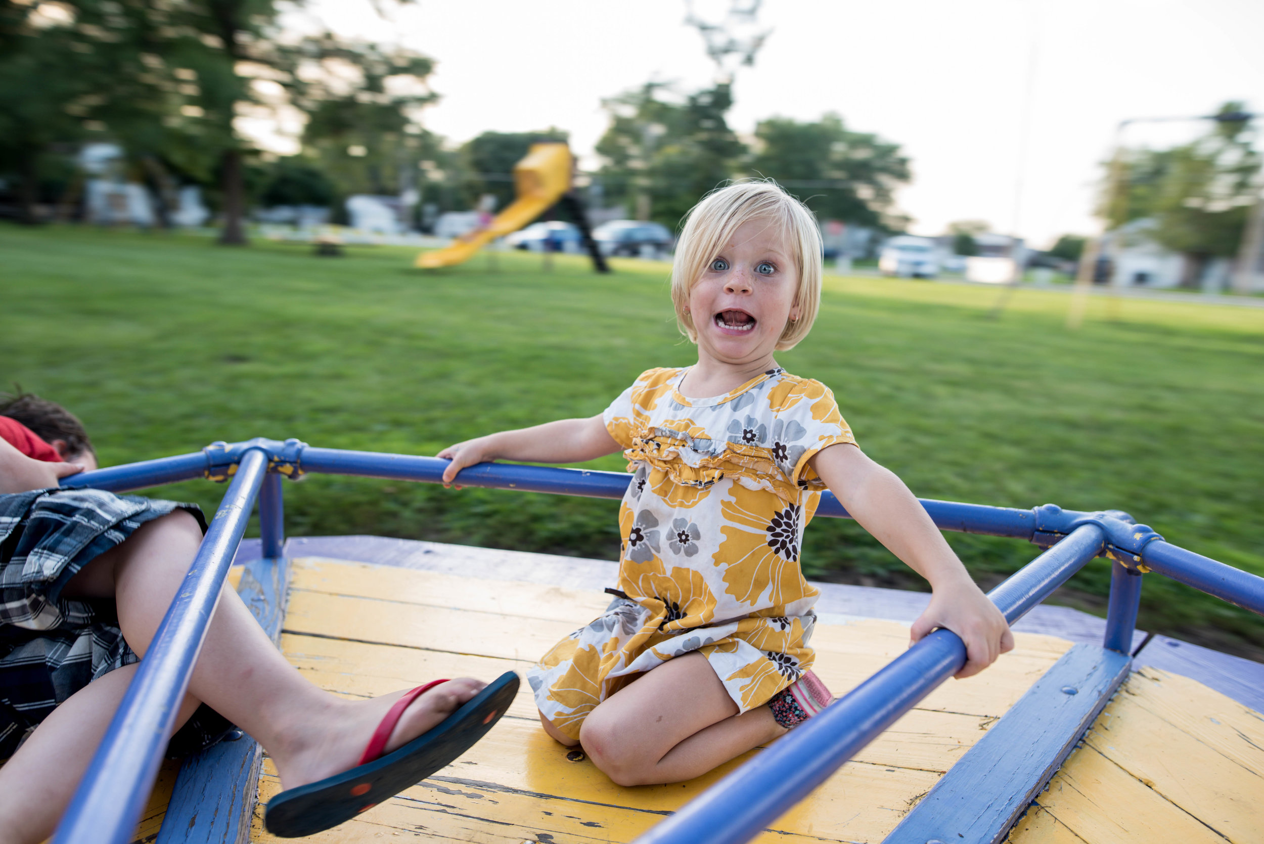 child on merry go round at williamsville illinois park