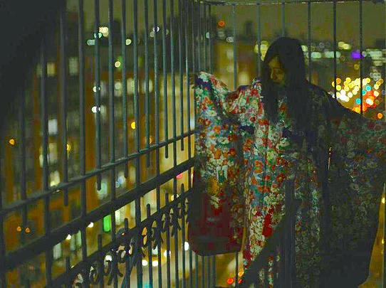 Kelima K, in a ceremonial kimono, from her atelier window in Soho, overlooking Houston and Mercer St. photo by Nicolas Pier-Morin