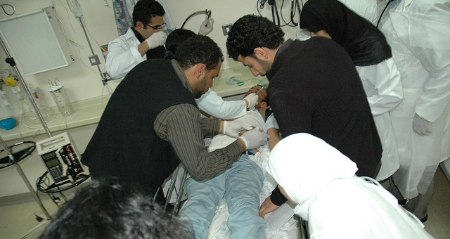 bahraini-medical-workers-help-injured-protester-photo-by-bahrainiac.jpg