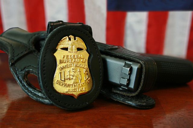 fbi-badge-gun-source-wikipedia.jpg