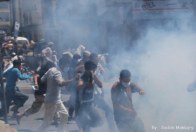 yemeni-protesters-teargas-photo-by-sadek-maktary.jpg