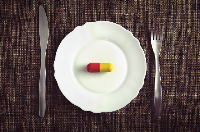 pill-on-plate-fork-knife-photo-by-sean-mcgrath.jpg