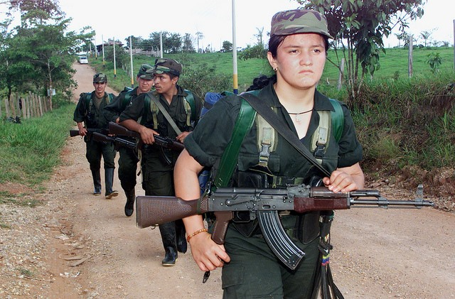 columbia female farc fighter on the march, photo by reuters courtesy of trustorg