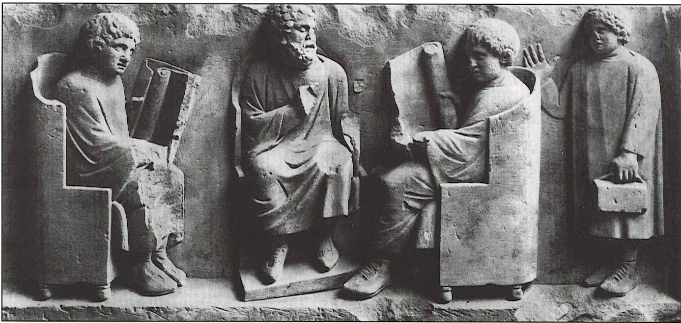A young boy arrives late for class. Detail from a funerary monument (c. 185 CE),found at Neumagen near Trier and held at the  Rheinisches Landesmuseum Trier . Image unattributed, found at  The Classics Library .