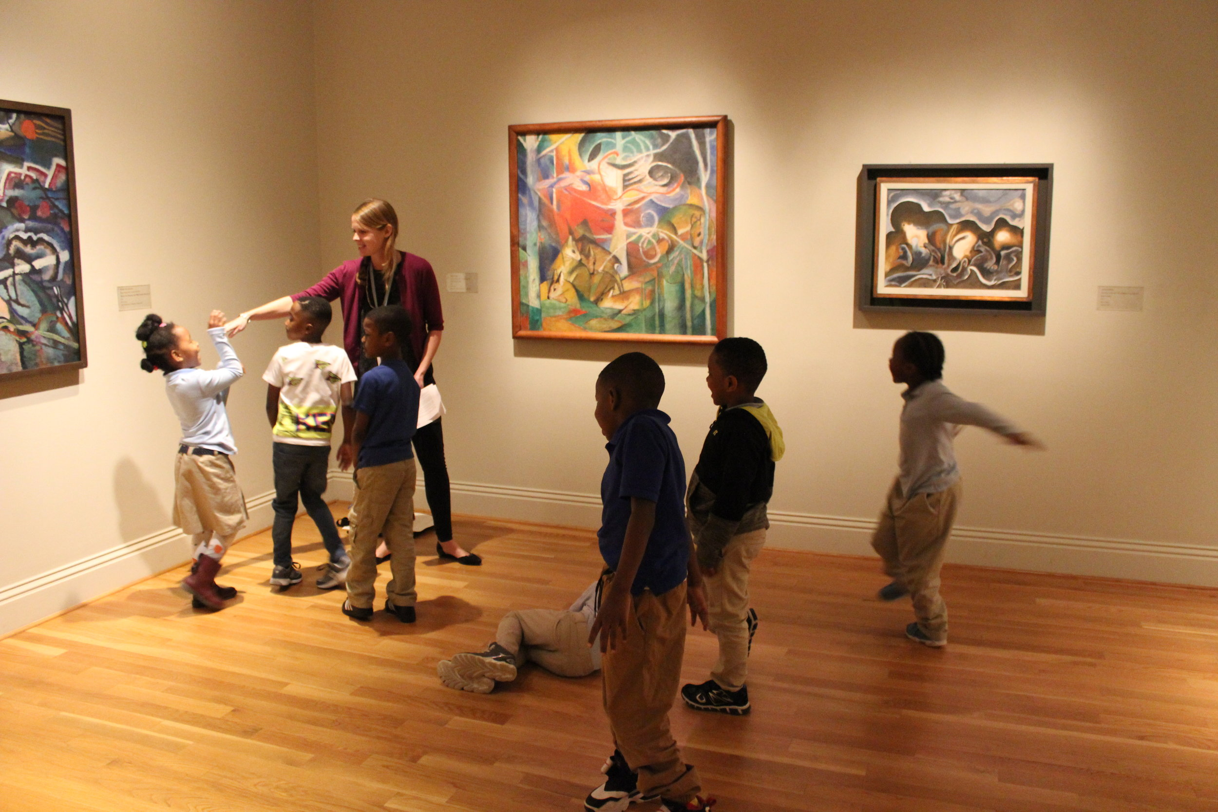 The Phillips Collection and Turner Elementary School, 2017 - 2018  Washington, DC Arts Integration Teaching Artist  I worked as an arts integration educator with 1st and 2nd grade students at Turner Elementary School. Students were asked to engage with art in a dynamic and meaningful way as they connected it to their classroom learning. I created the core-connected lessons and implemented them with the help of classroom teacher collaboration.  This is an image of students engaging with a kinetic art observation activity in the museum.