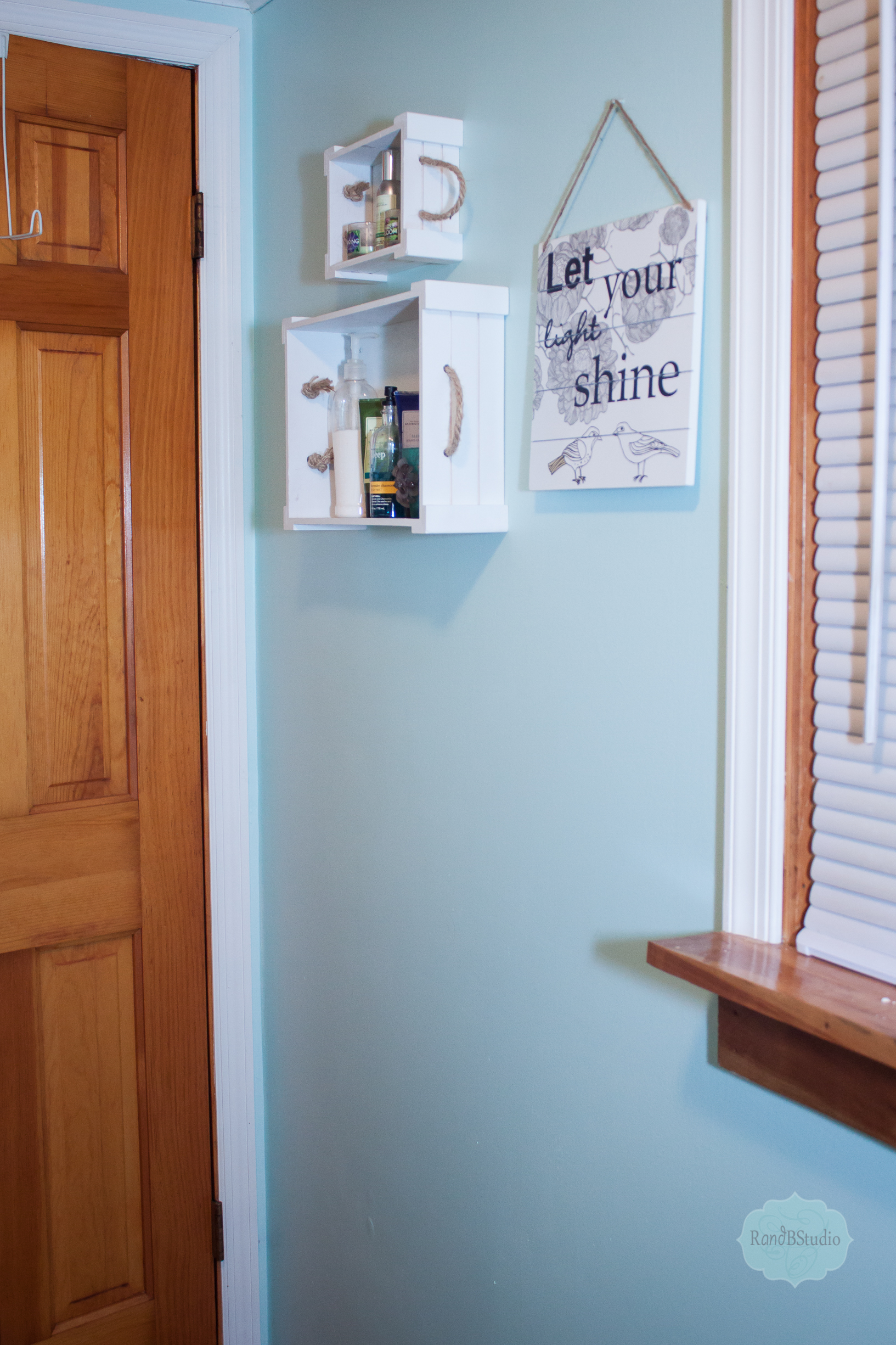 We spruced up our bathroom with a few pieces.    I picked up this cute hanging sign at Hobby Lobby 50% off.    These boxes I also picked up at Hobby Lobby for a few bucks, they were unfinished wood so Iuntied the handles and did two coats of spray paint and now we have two little shelves.