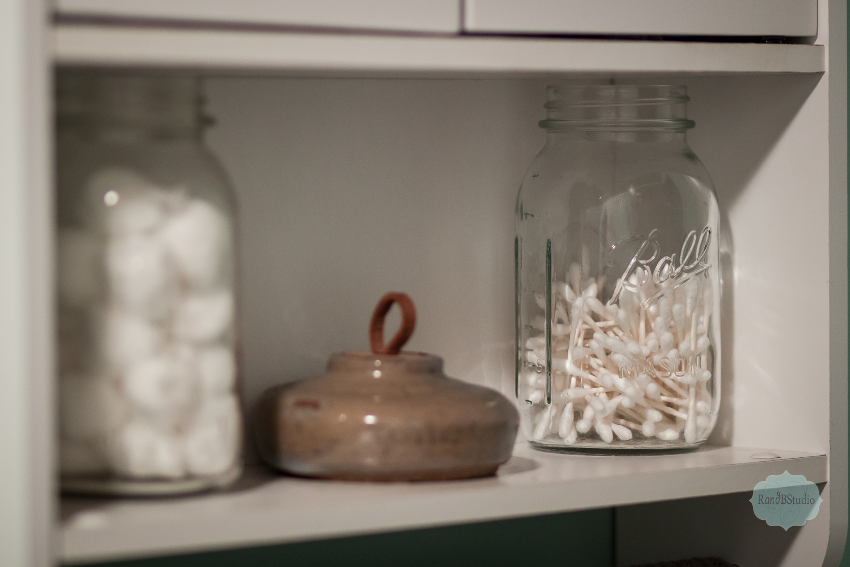 I love Mason jars for storing items. We use them in our bathroom for cotton balls and q-tips. We also use them in our kitchen for utensils.    I will be posting more rooms in the near future. :)