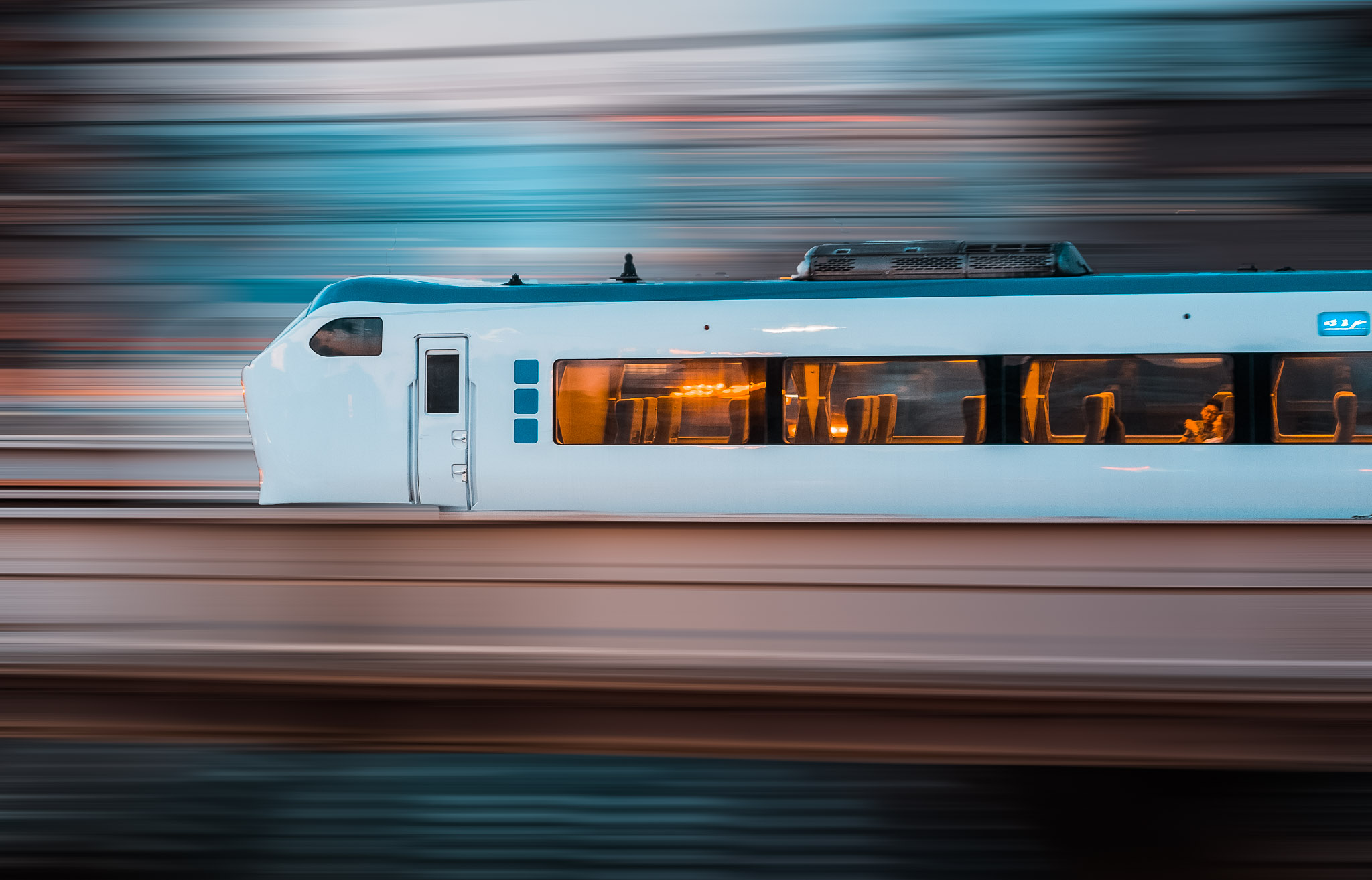 Train Spotting in Osaka - Panning Handheld @ 1/15th-1/30th. (Motion Blur Filter added in PS)